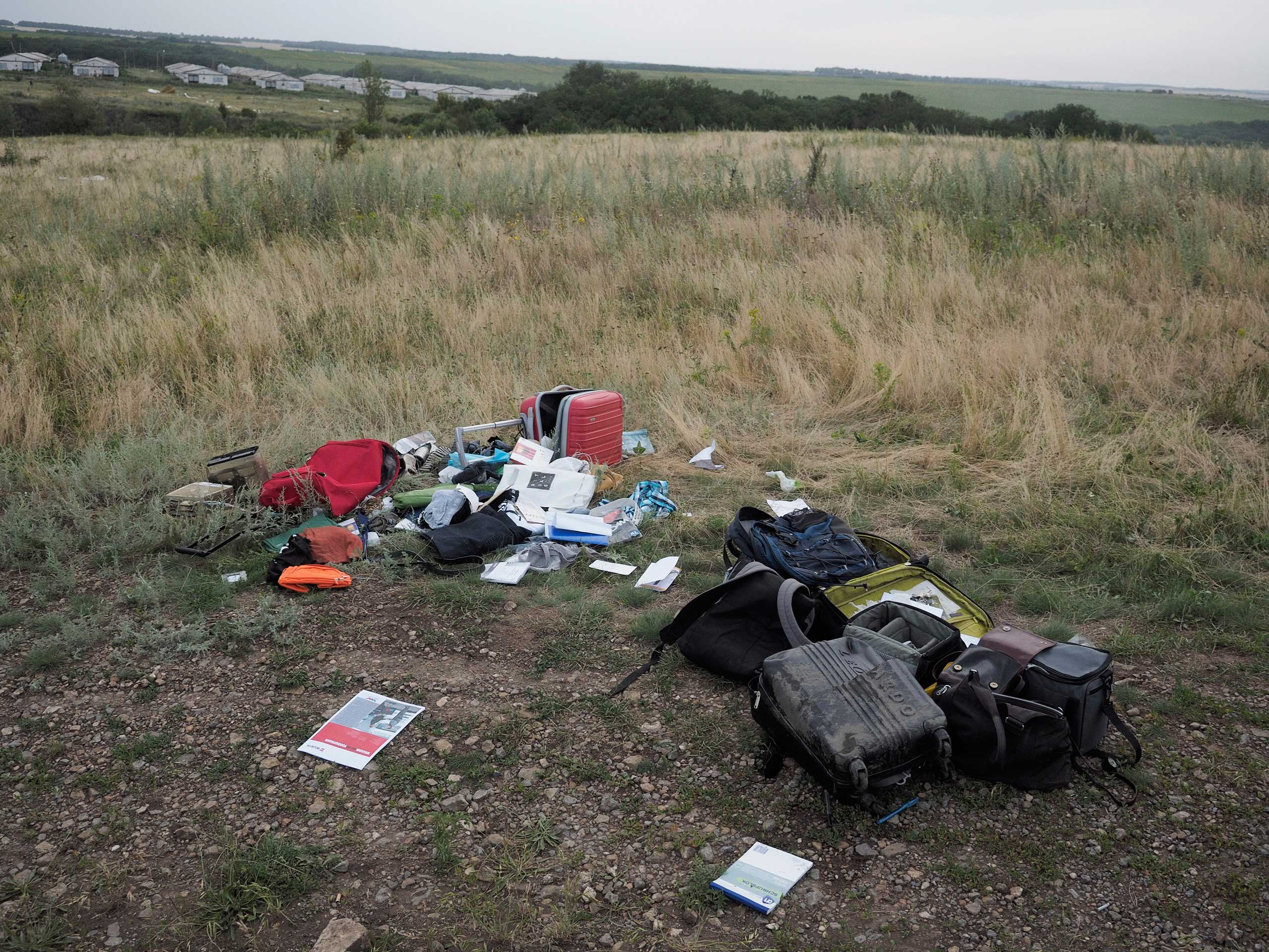 Luggage at the crash site of the Malaysian airliner reportedly carrying 298 people from Amsterdam to Kuala Lumpur, near the town of Shaktarsk, in rebel-held east Ukraine on July 17, 2014.