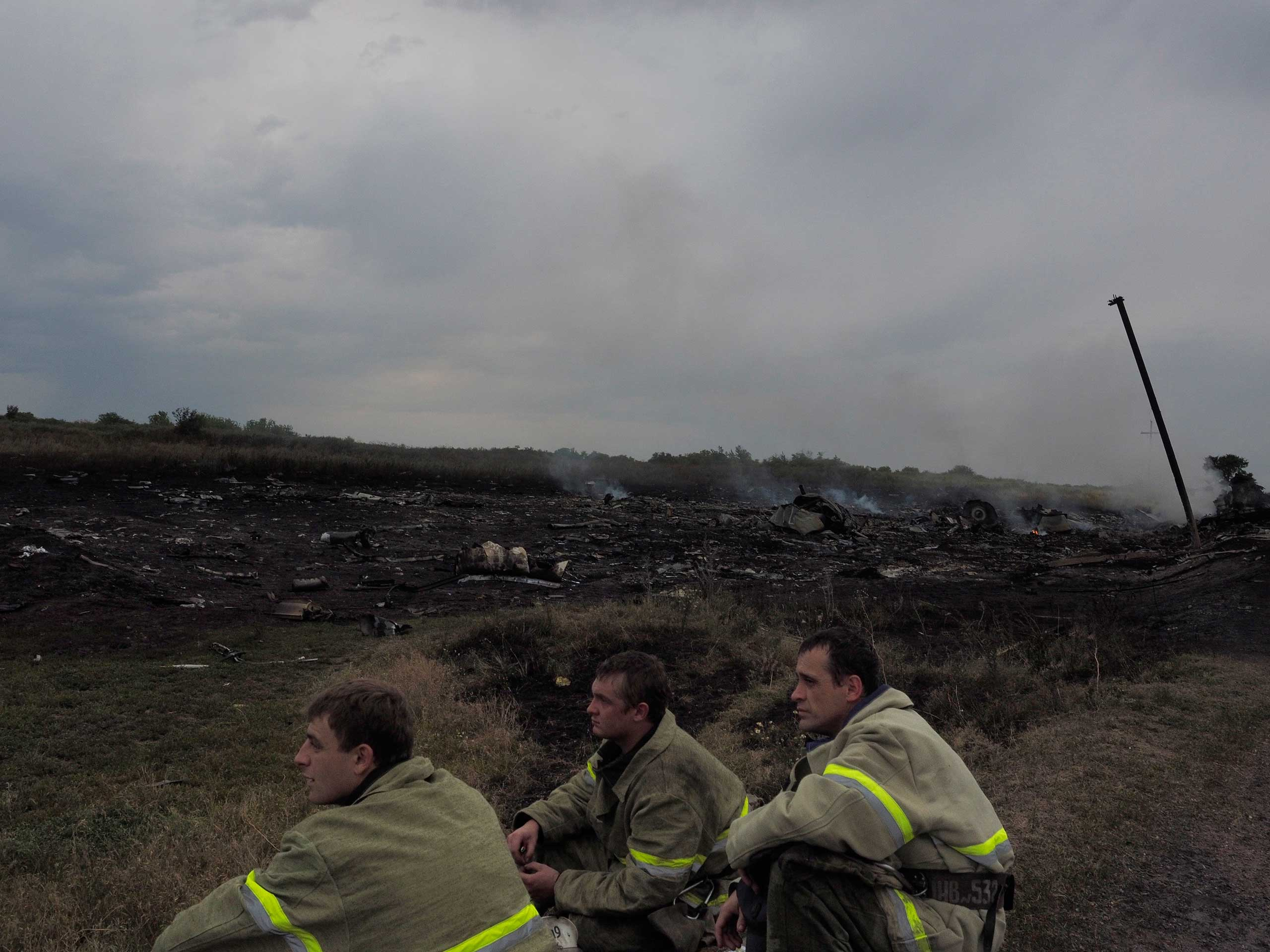 Firefighters at the crash site of Malaysia Airlines flight MH17 in Torez, eastern Ukraine, July 17, 2014.