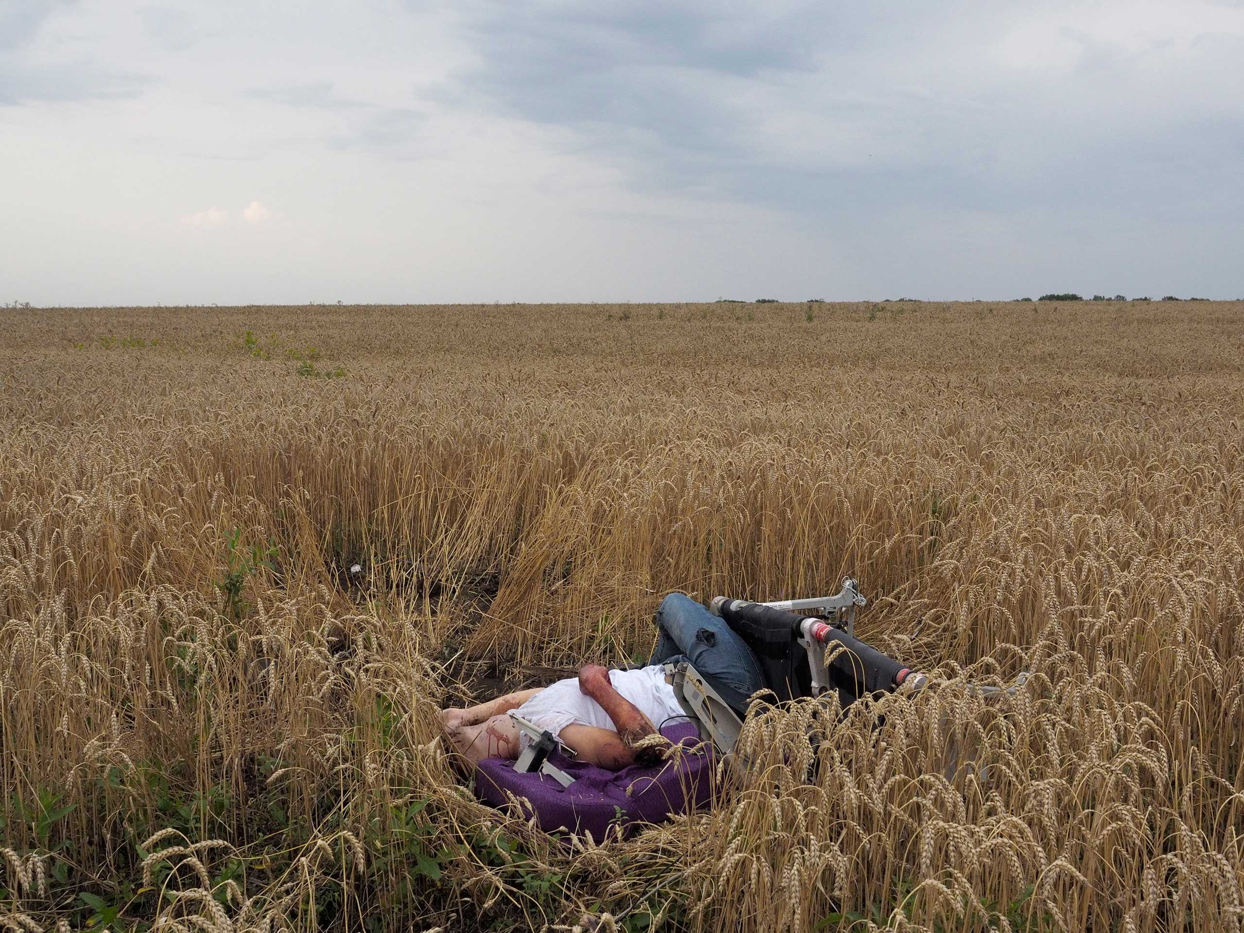 The remains of a passenger on board Malaysia Airlines flight MH17 that was shot over eastern Ukraine, July 17, 2014.