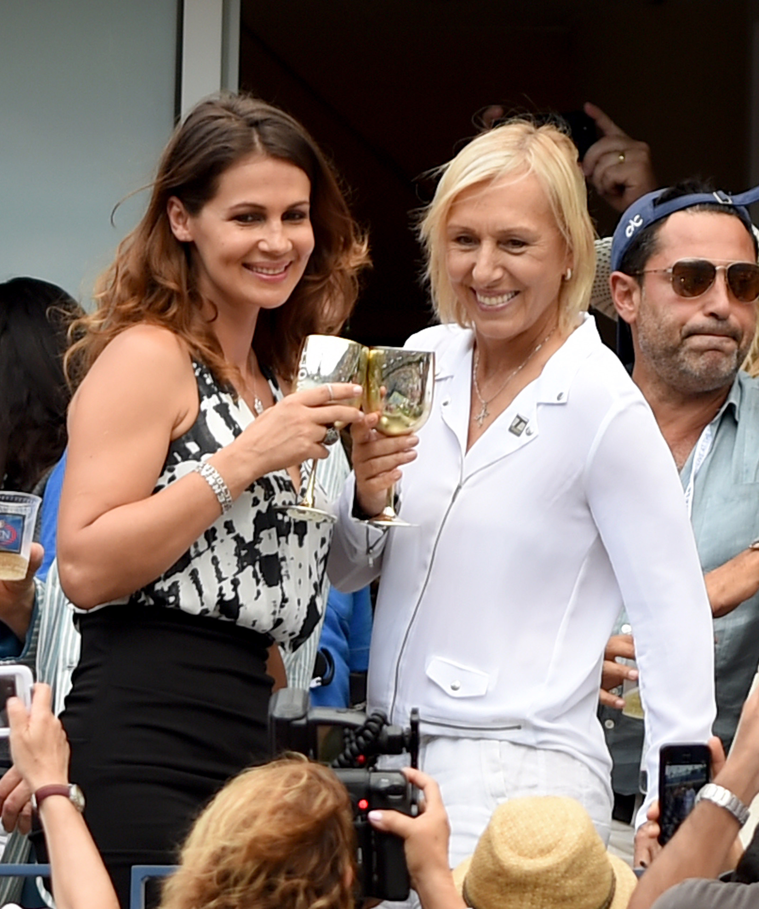 Martina Navratilova, right, and Julia Lemigova celebrate their engagement during the 2014 U.S. Open in New York City on Sept. 6, 2014
