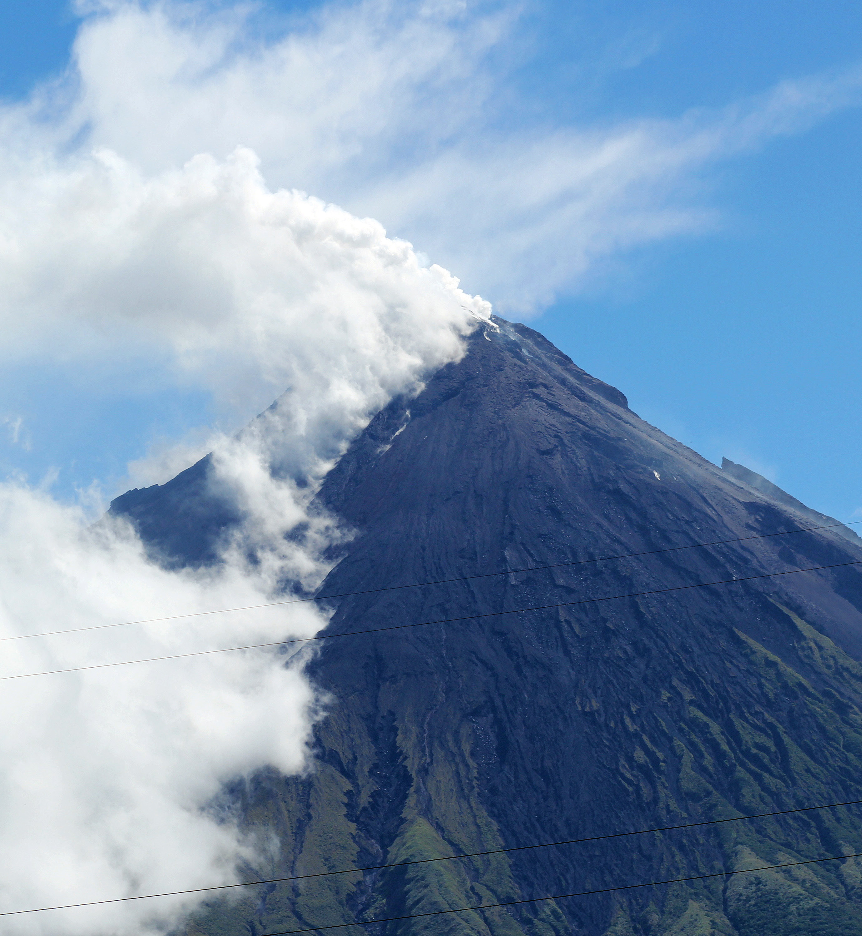 Volcano Mount Mayon spews a thick column of ash 500 metres (1,600 feet) into the air, as seen from the city of Legazpi, albay province, southeast of Manila on May 7, 2013.