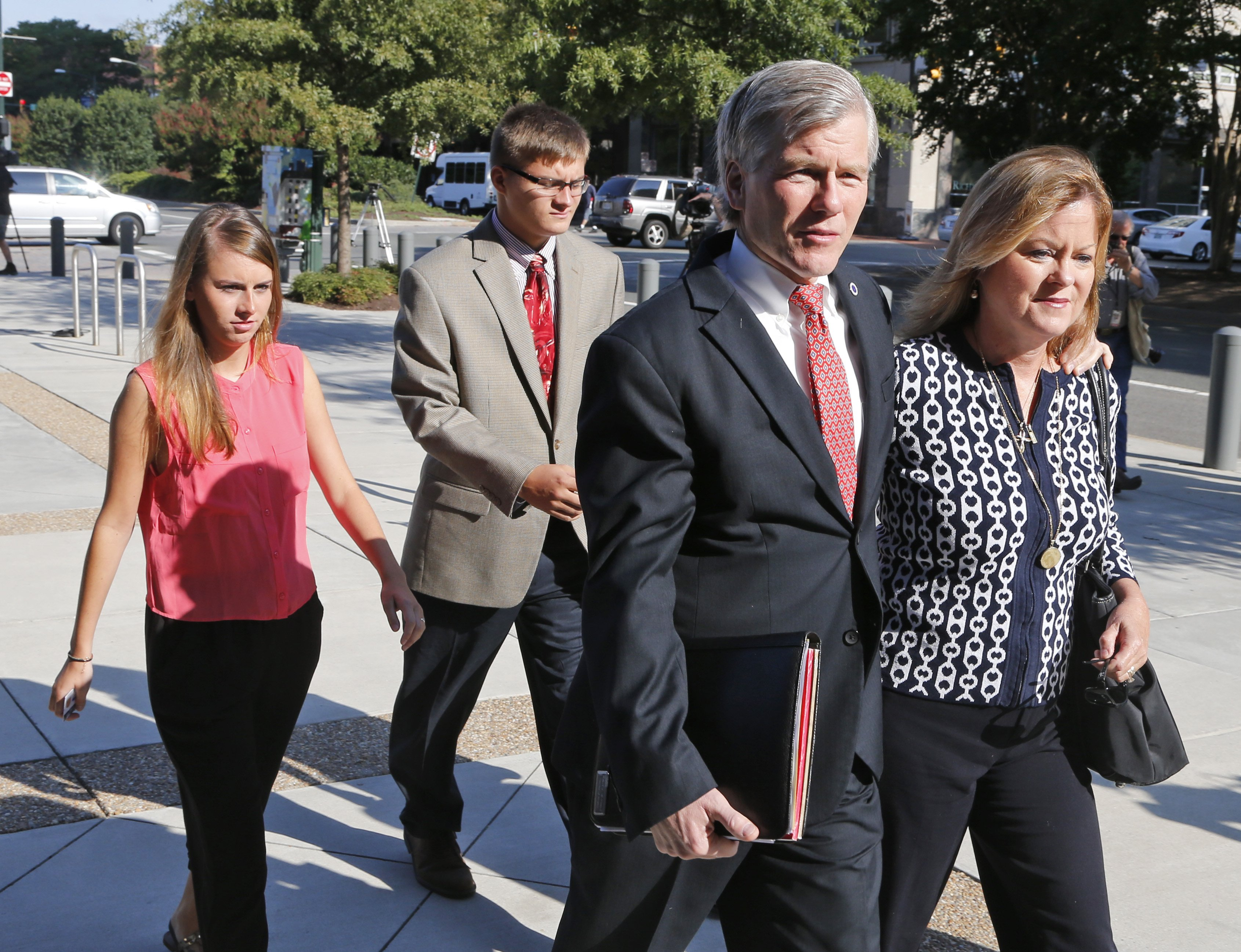 Former Virginia Gov. Bob McDonnell, second left, talks to his sister Eileen Reinamanas they arrive at federal court for the third day of jury deliberations in his corruption trial in Richmond, Va., Thursday, Sept. 4, 2014.