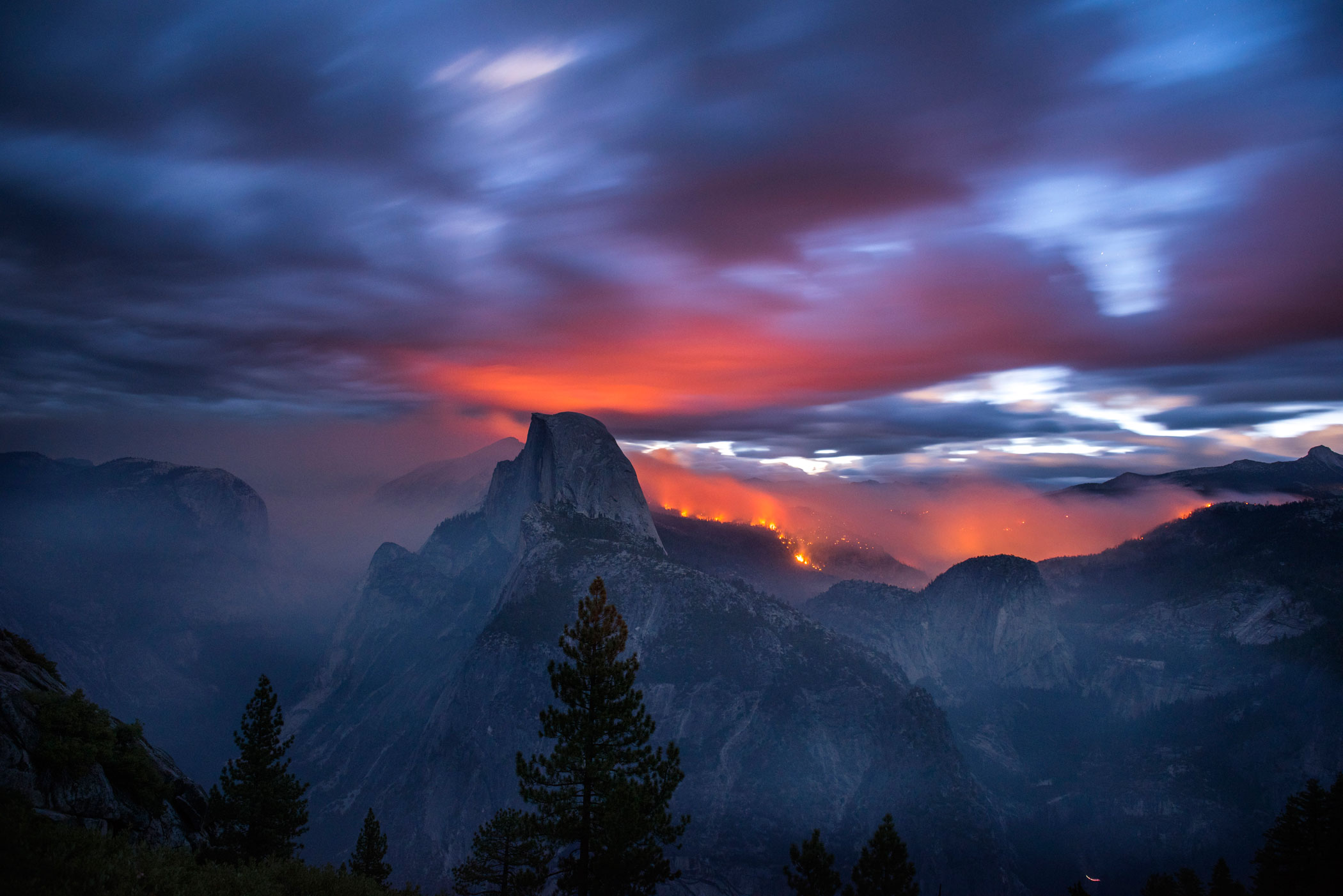 The Meadow Fire burns at dawn near Half Dome in Yosemite National Park early Monday September 8, 2014. As of Wednesday the fire had burned over 4,500 acres and was 10% contained.