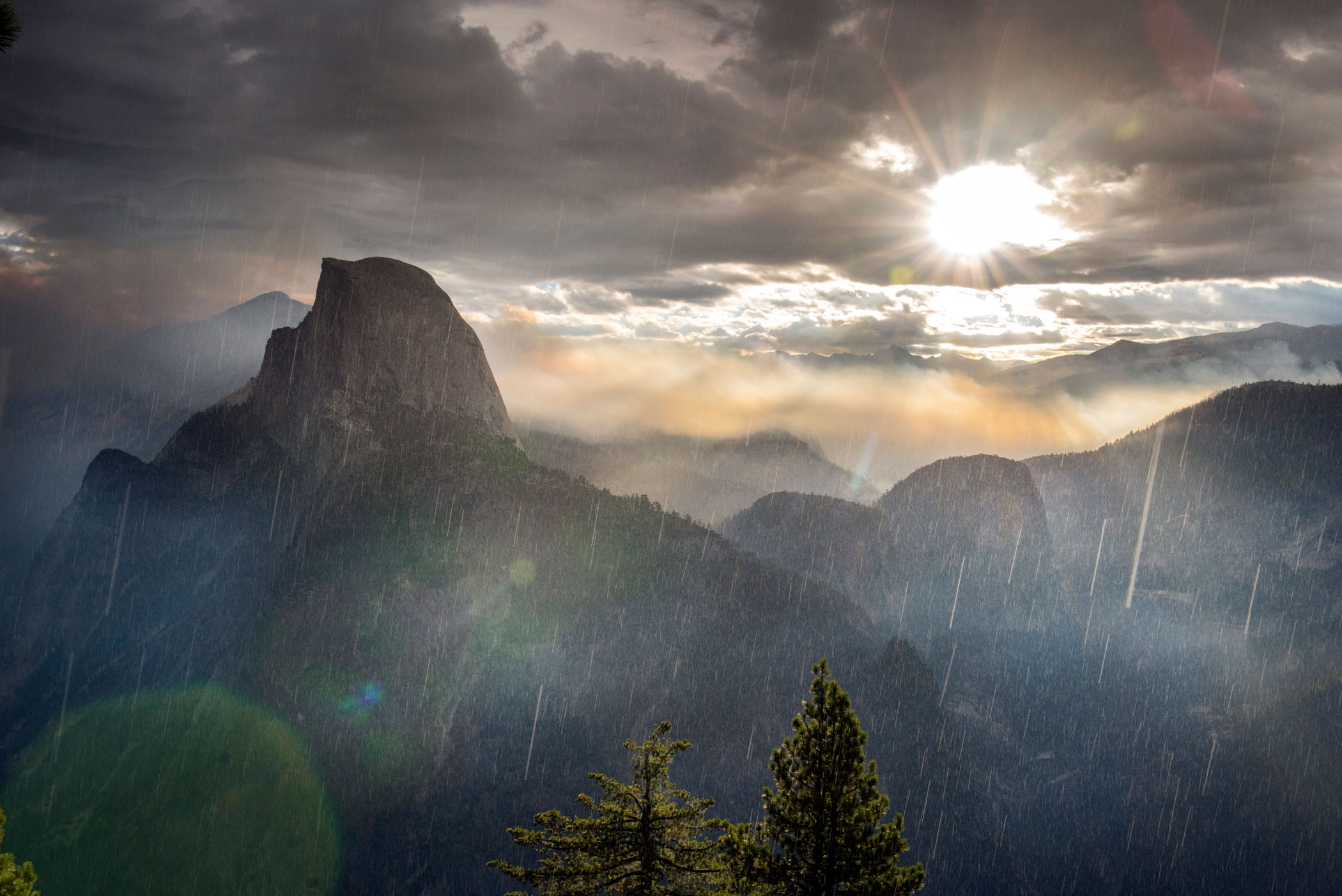 The Meadow Fire burns at dawn near Half Dome in Yosemite National Park early Monday September 8, 2014 as rain moves in from the south. As of Wednesday the fire had burned over 4,500 acres and was 10% contained.