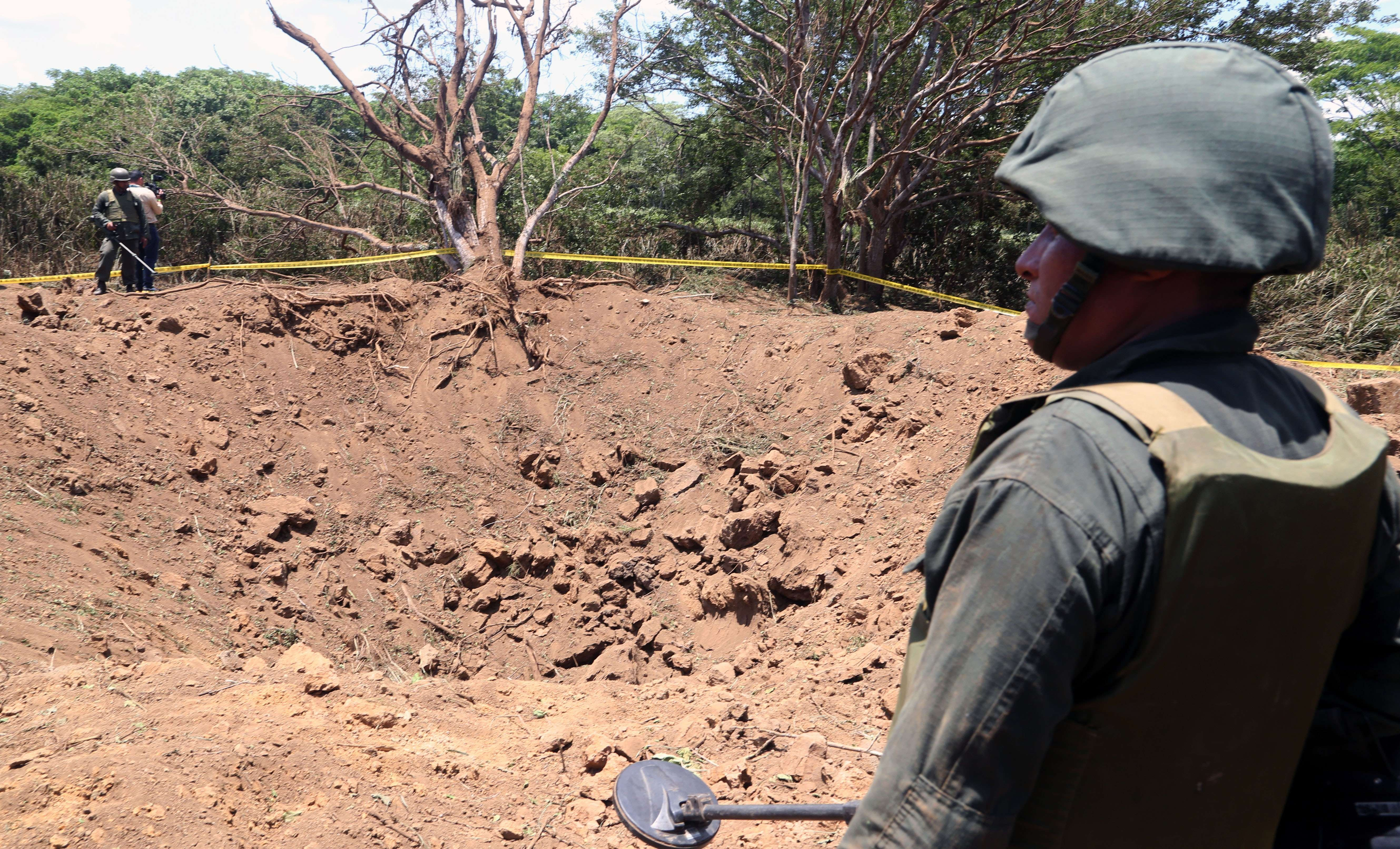 A Nicaraguan soldier checks the site where an alleged meteorite struck on Sept. 7, 2014 in Managua.