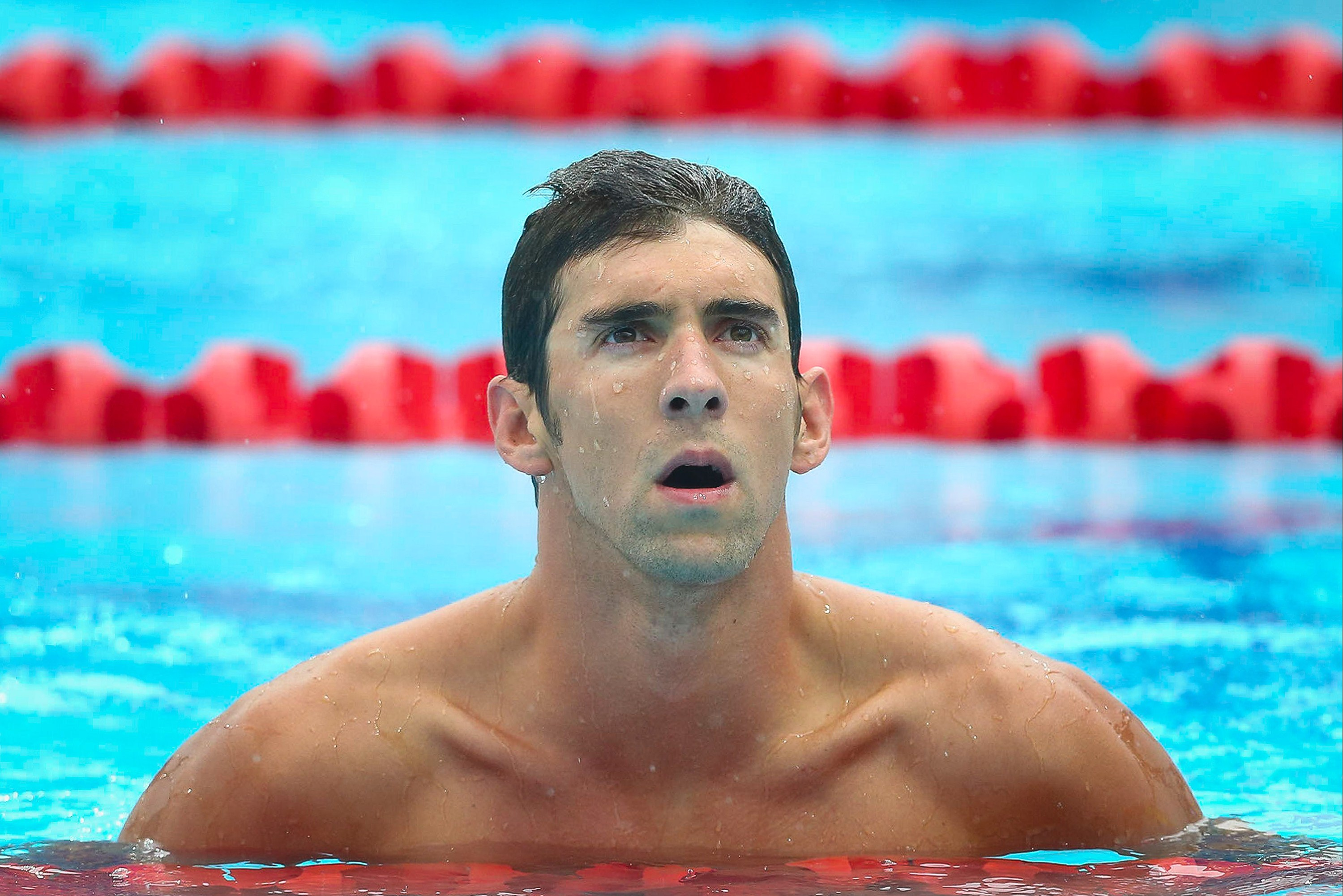Michael Phelps of the US reacts following the men's 100 m butterfly heat at the Gold Coast Aquatic Centre on the Gold Coast in Australia on Aug. 23, 2014.