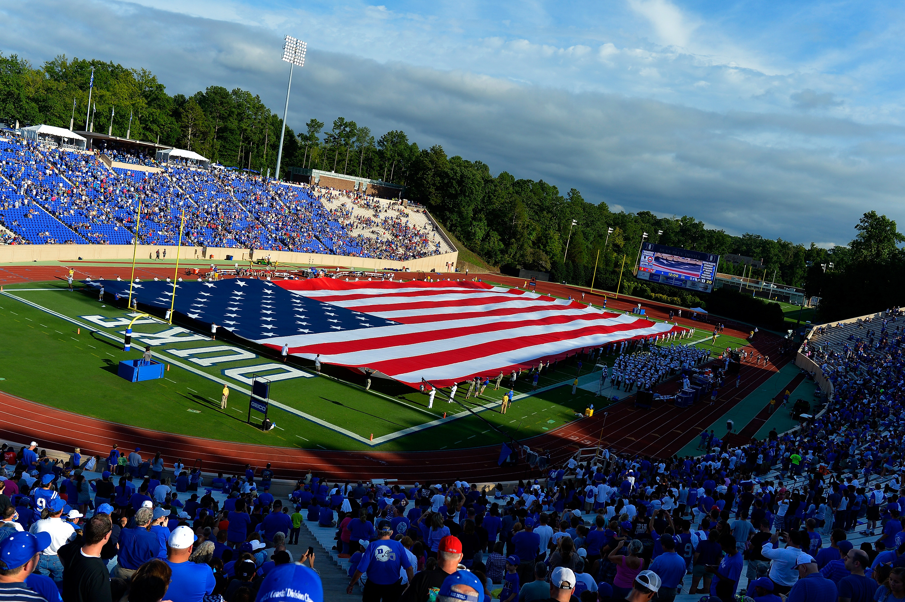 A stadium-sized American flag is displayed for Military Appreciation Day during halftime of the game between the Kansas Jayhawks and the Duke Blue Devils at Wallace Wade Stadium on September 13, 2014 in Durham, North Carolina.