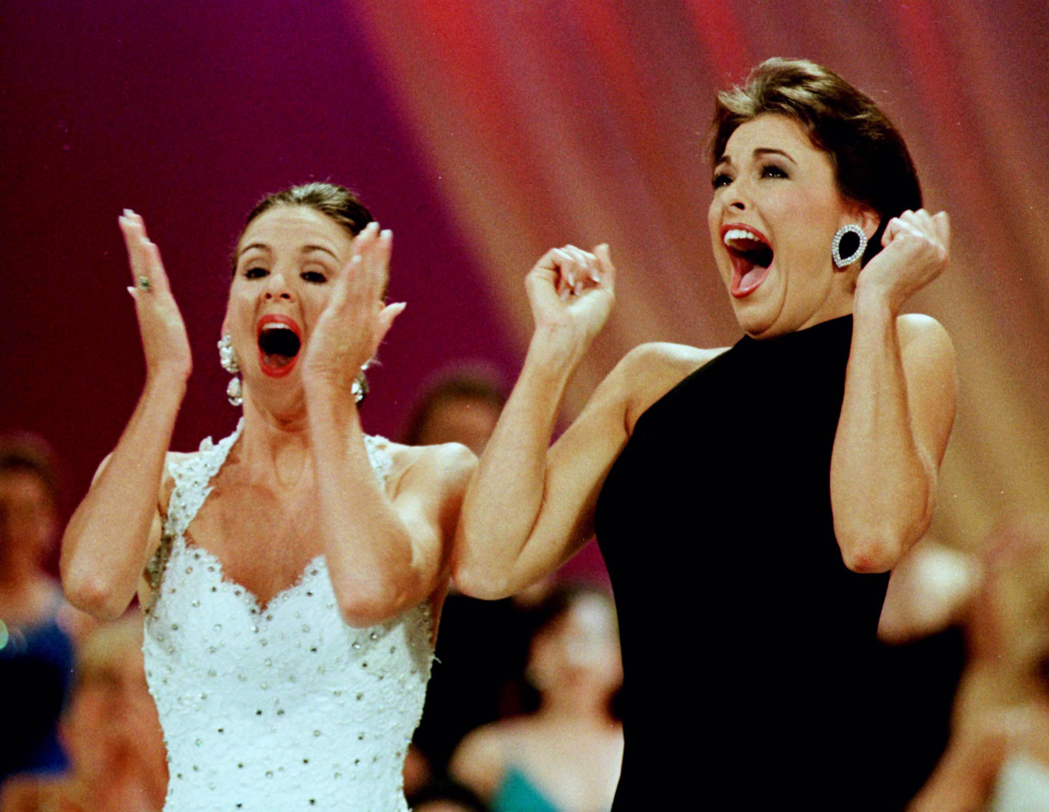 Miss America 1999 Nicole Johnson (R) from Virginia reacts with first runner up Kelli Bradshaw (L) from North Carolina, after Johnson was named Miss America 1999 in Atlantic City, New Jersey on Sept. 21, 1998.