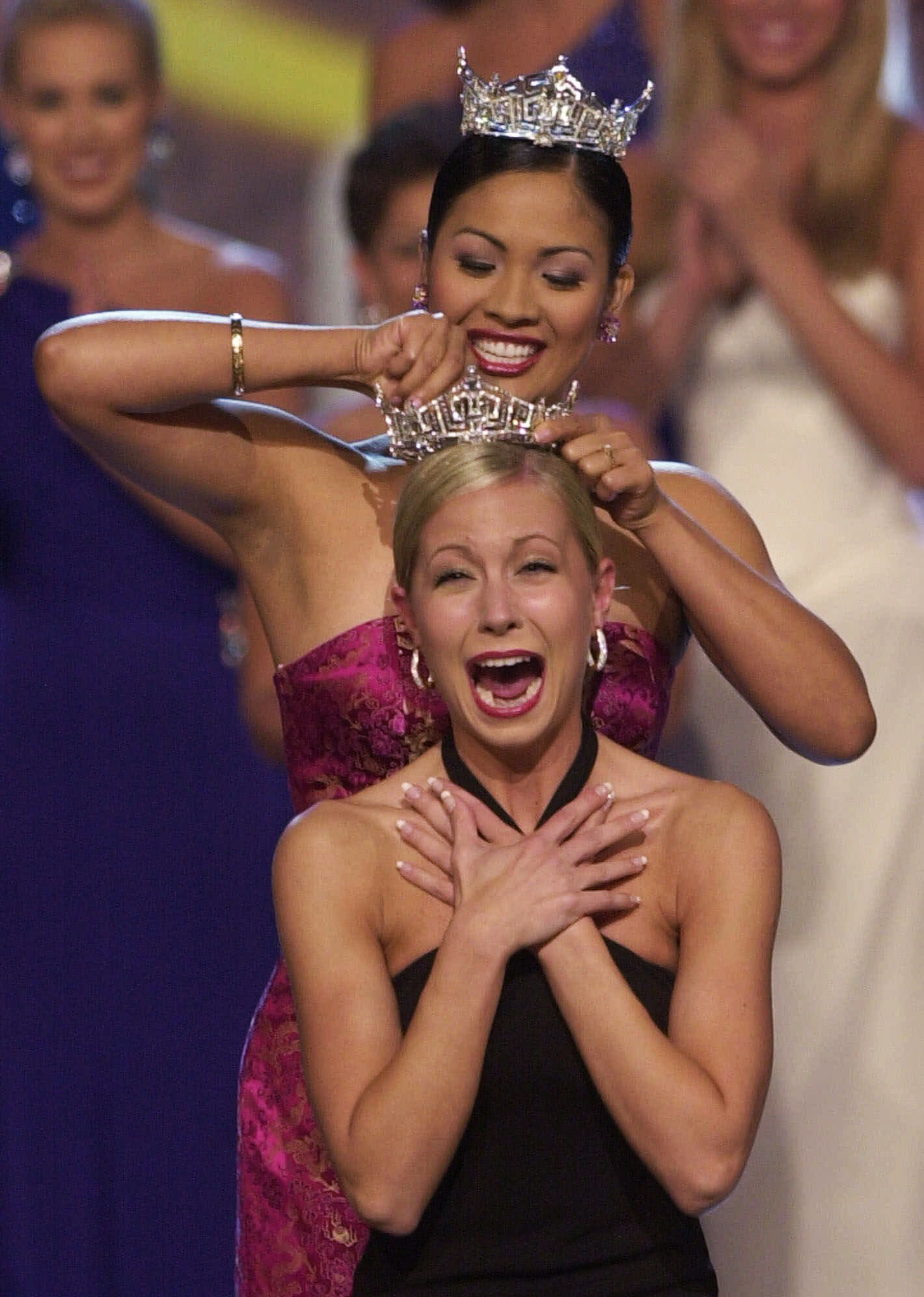Former Miss America Angela Perez Baraquio, top, crowns Miss Oregon Katie Harman as Miss America 2002, during the Miss America Pageant in Atlantic City, N.J. on Sept. 22, 2001.