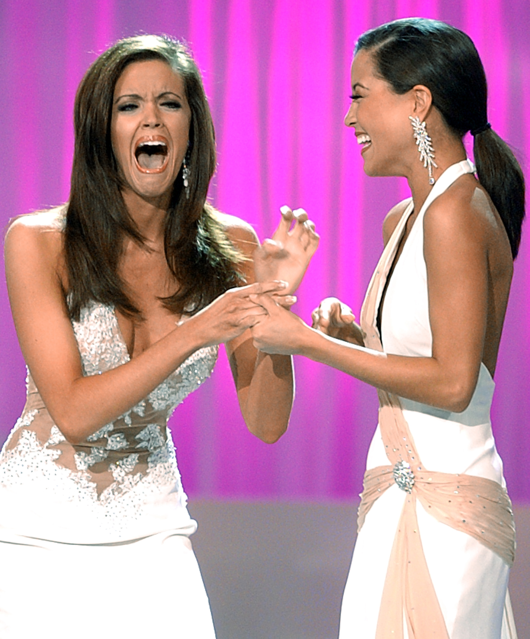 Miss Oklahoma Jennifer Berry reacts with Miss Georgia Monica Pang (R) after being named Miss America 2006 at the conclusion of the Miss America pageant in Las Vegas on Jan. 21, 2006