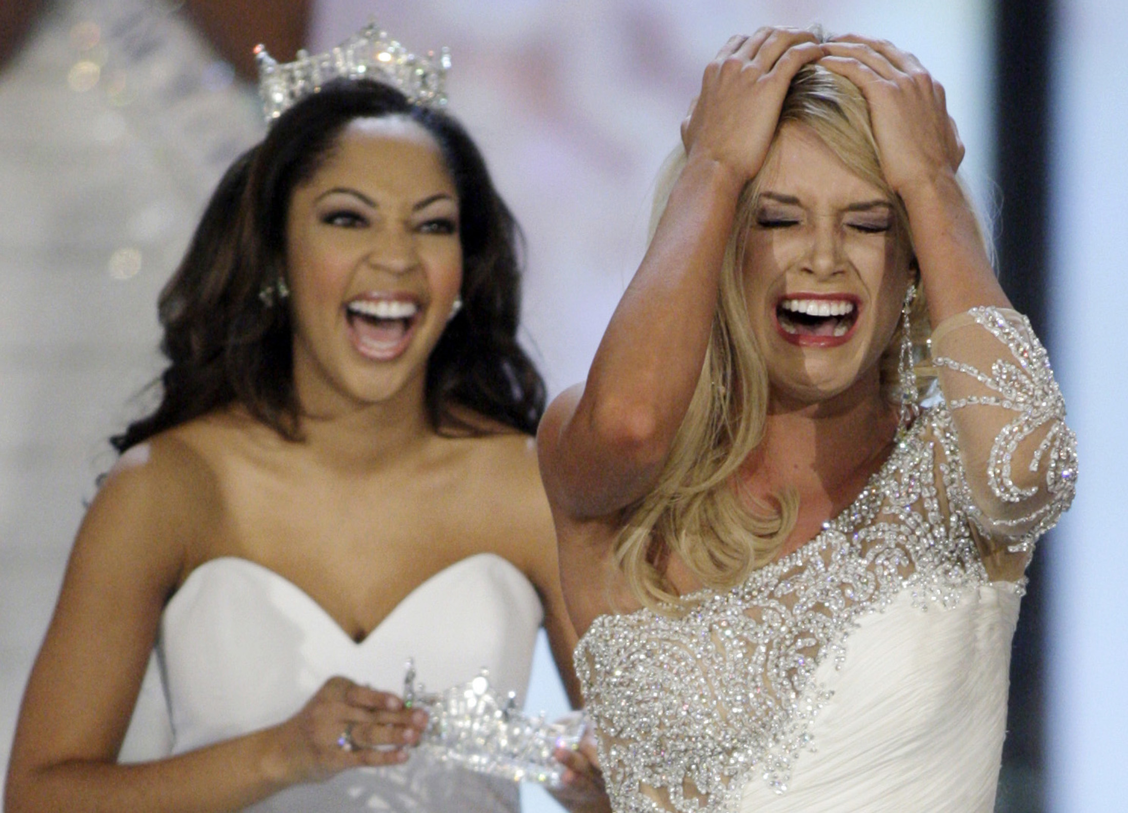 Miss Nebraska Teresa Scanlan (R), 17, reacts after being announced Miss America 2011 during the Miss America Pageant in Las Vegas, Nevada on Jan. 15, 2011.