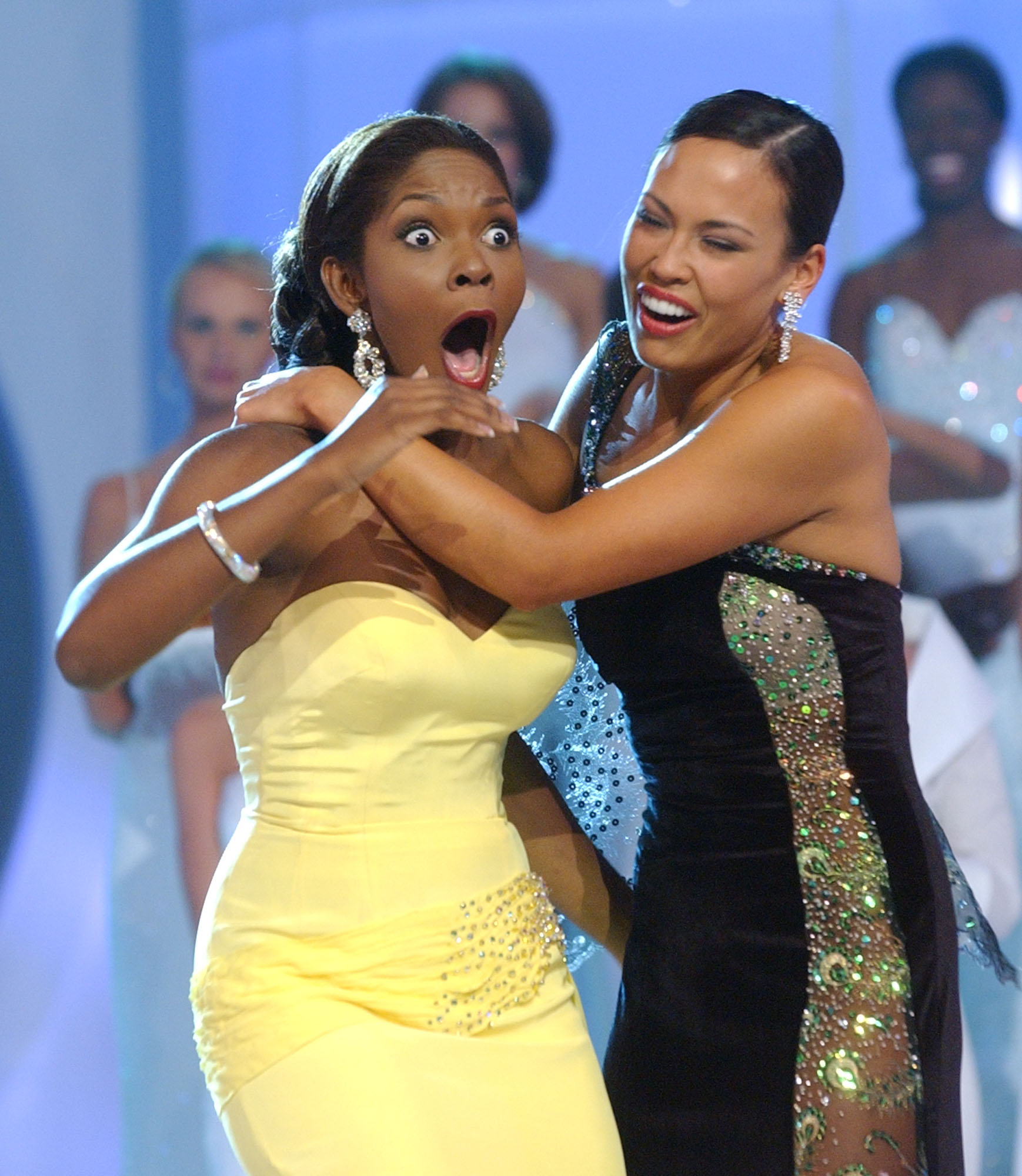 Ericka Dunlap, left, reacts after being named Miss America 2004 as she is embrace by first runner-up Kanoelani Gibson on Sept. 20, 2003, in Atlantic City, N.J.