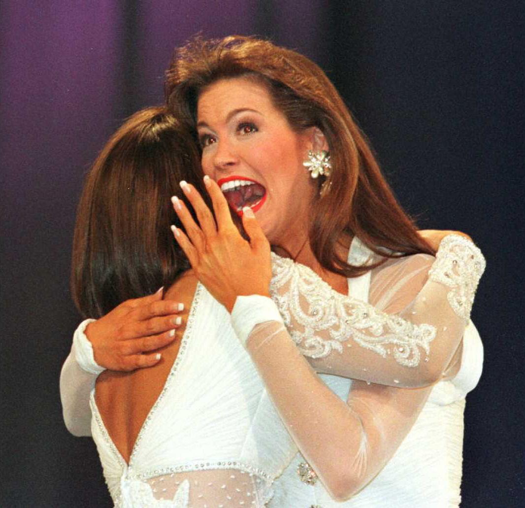 Tara Dawn Holland (R), Miss Kansas, reacts upon being named Miss America 1997, as she hugs second runner-up Kimberly Massaro, Miss Missouri, on Sept. 15, 1996 in Atlantic City, NJ.