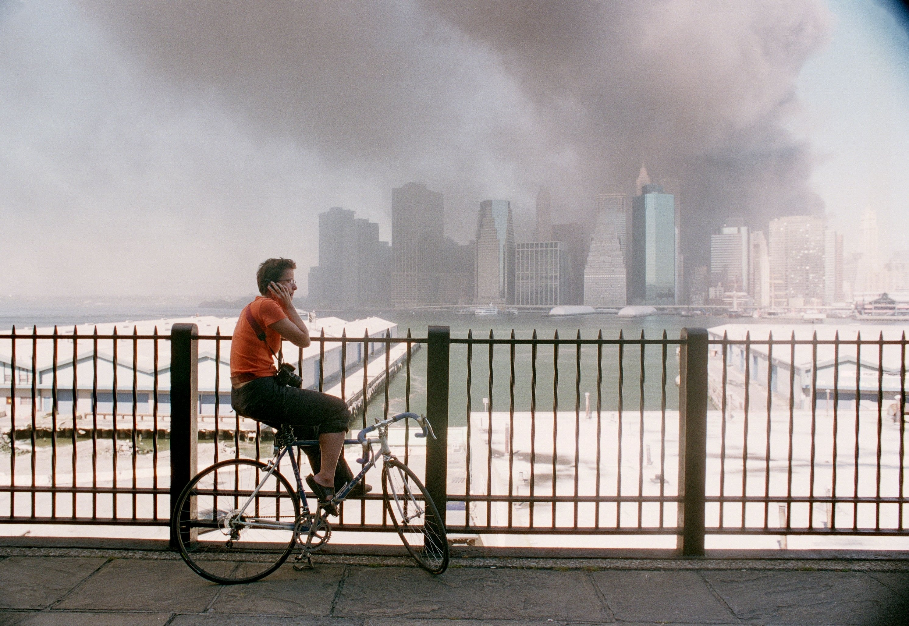 <strong>2001</strong>                                   A woman watches smoke pour out of the World Trade Center Towers in New York on September 11.
