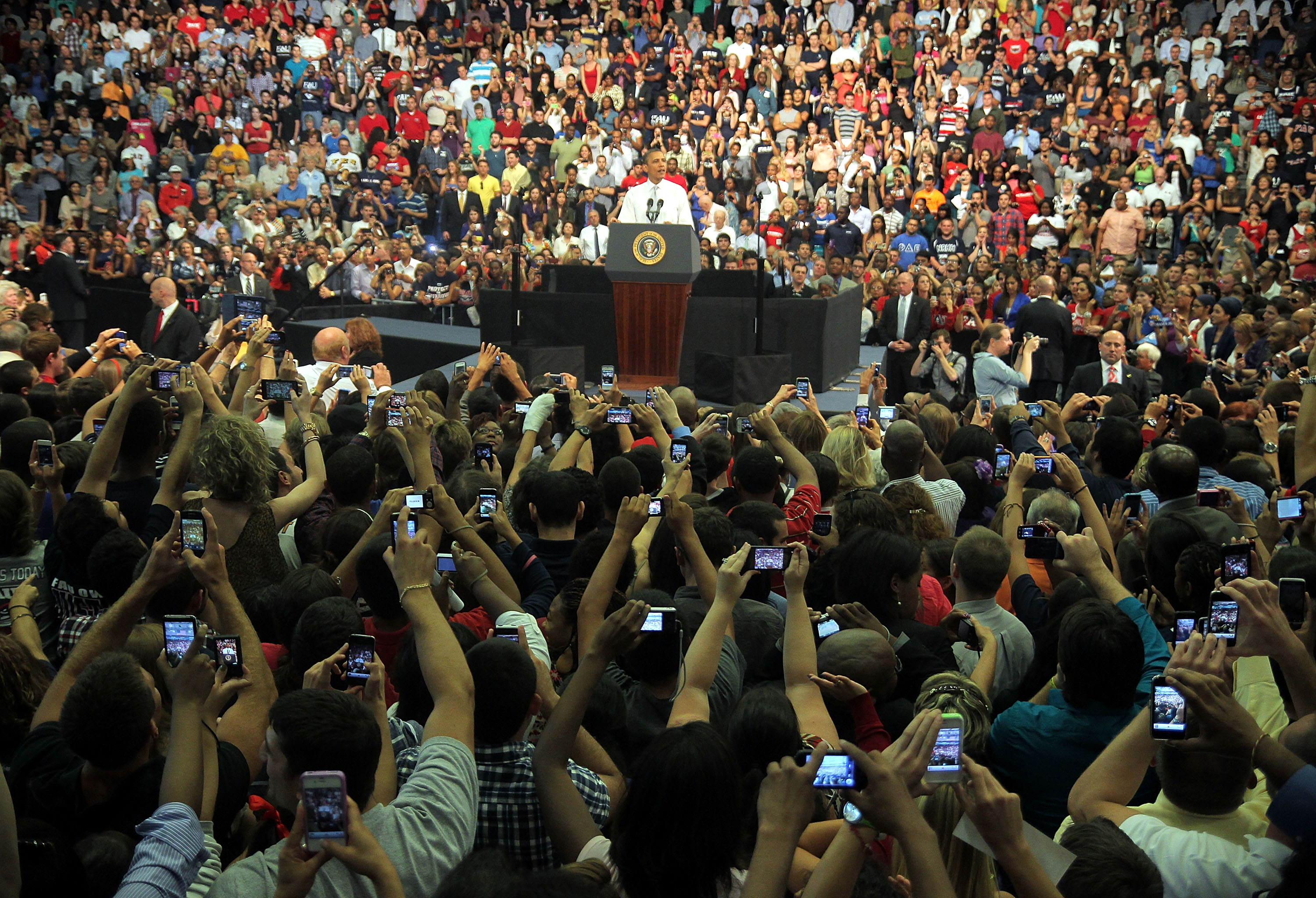 <strong>2012</strong>                                                                      Audience members take pictures of President Barack Obama at Florida Atlantic University on April 10 in Boca Raton, Florida.