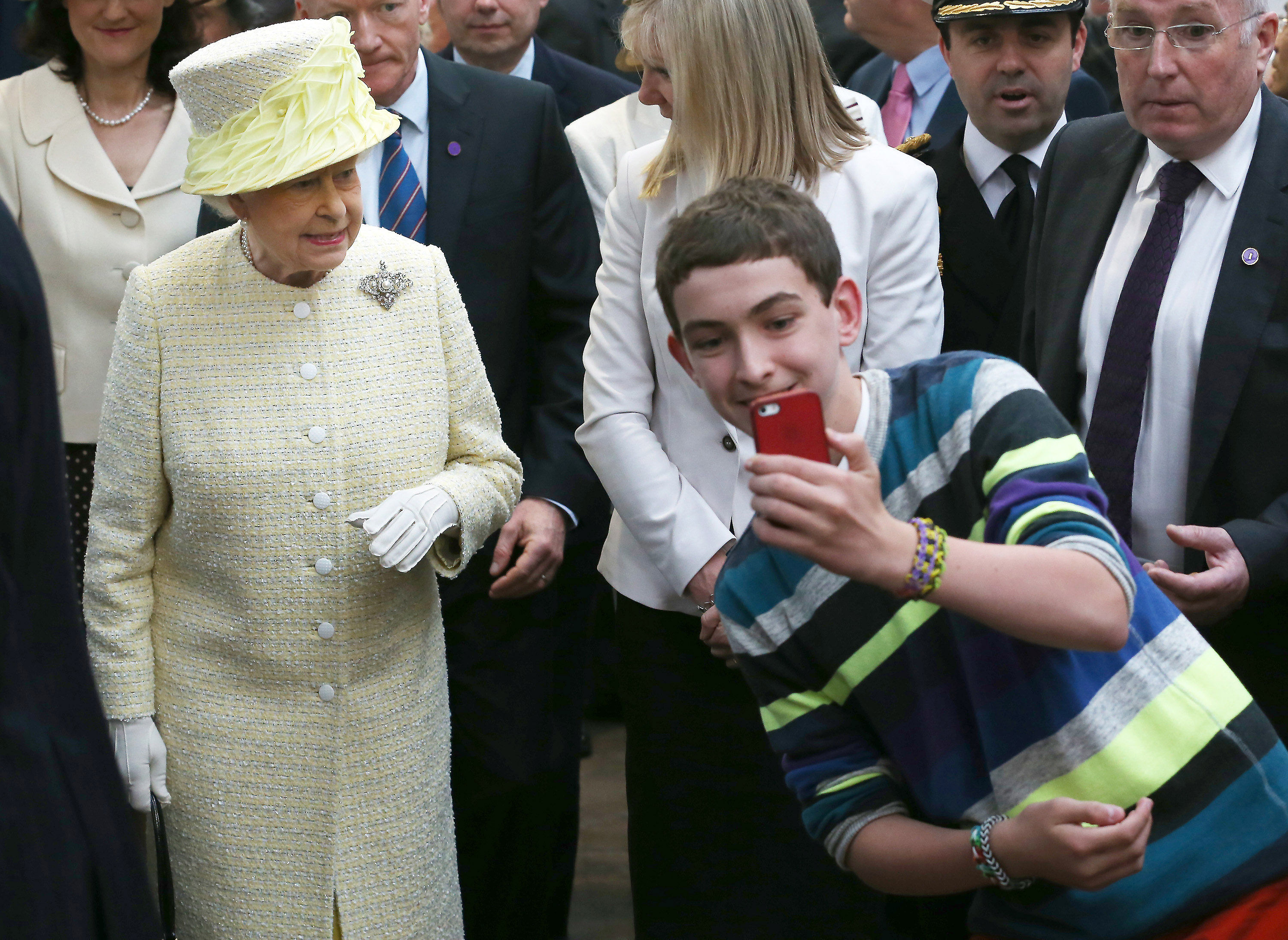 <strong>2014</strong>                                   A teenager takes a selfie in front of Queen Elizabeth II during a walk around St. Georges Market in Belfast. The Queen has apparently voiced her dismay that when she carries out engagements she is greeted by a sea of mobile phones.