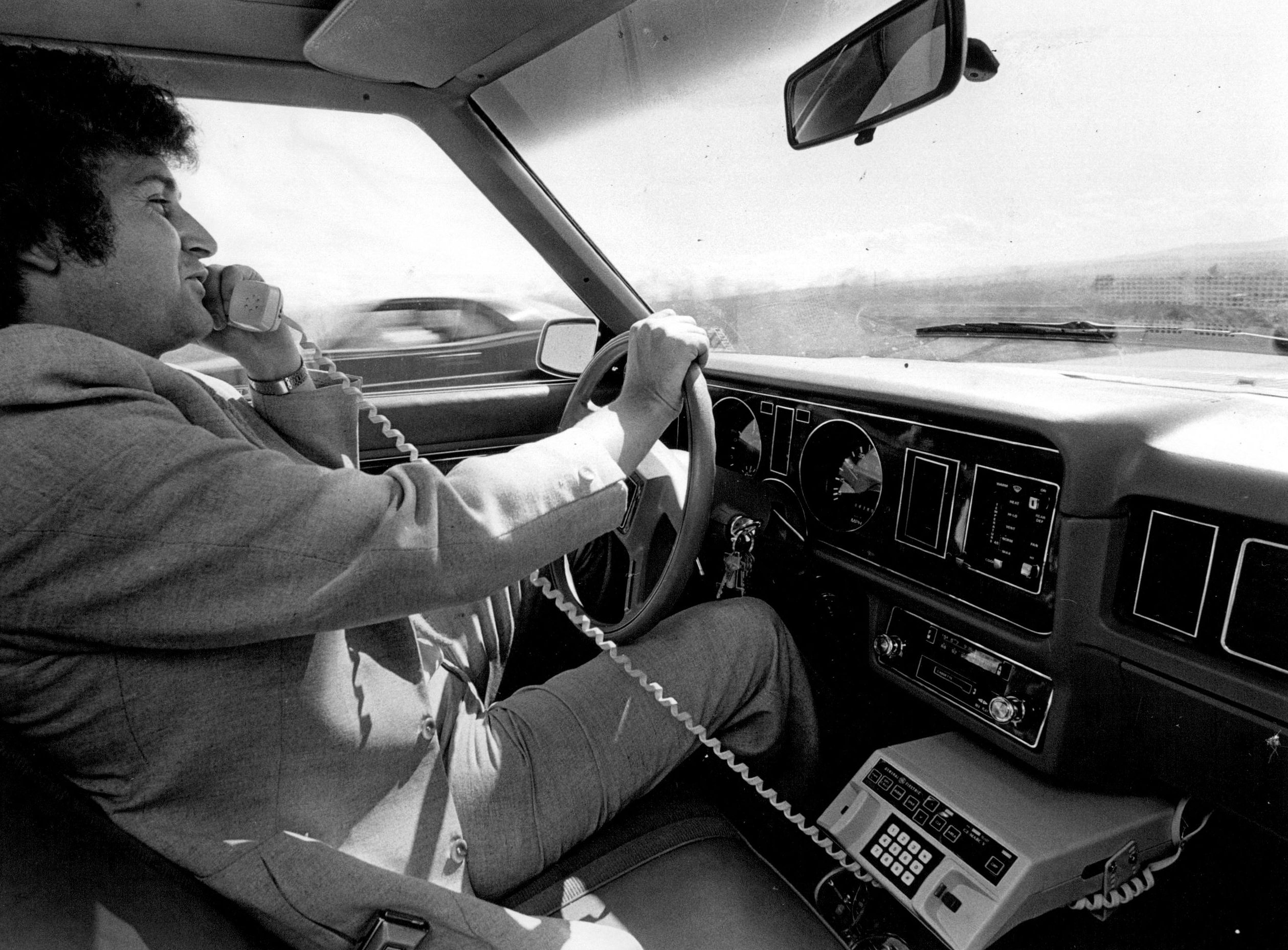 <strong>1983</strong>                                   Bob Maxwell, general manager of Englewood-based Mobile Telephone of Colorado, places a call on an FCC-approved radio frequency while driving to work.