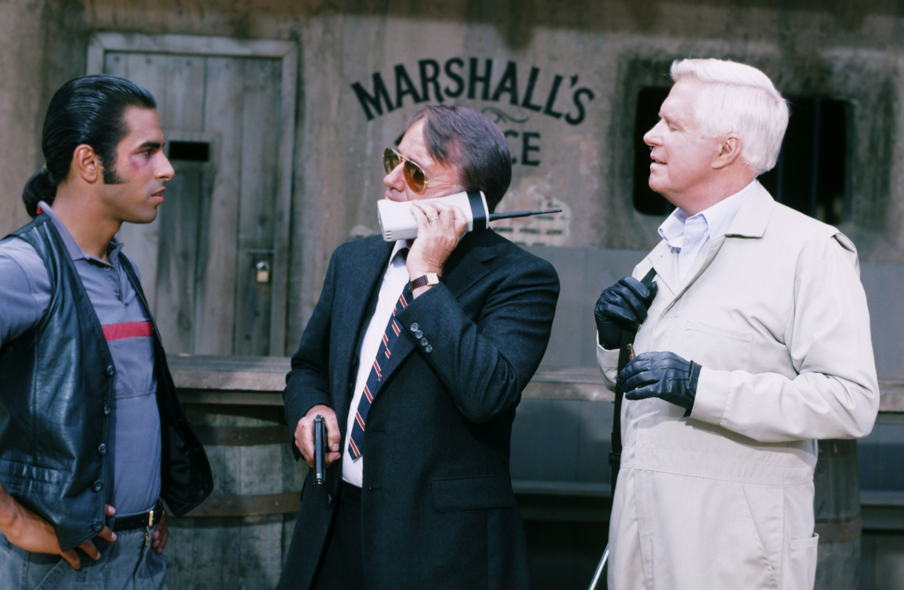 "<strong>1986</strong>                                   THE A-TEAM ""The Say U.N.C.L.E. Affair"" Episode 5. (l-r) Eddie Velez as Frankie Santana, Robert Vaughn as General Hunt Stockwell, George Peppard as John 'Hannibal' Smith."