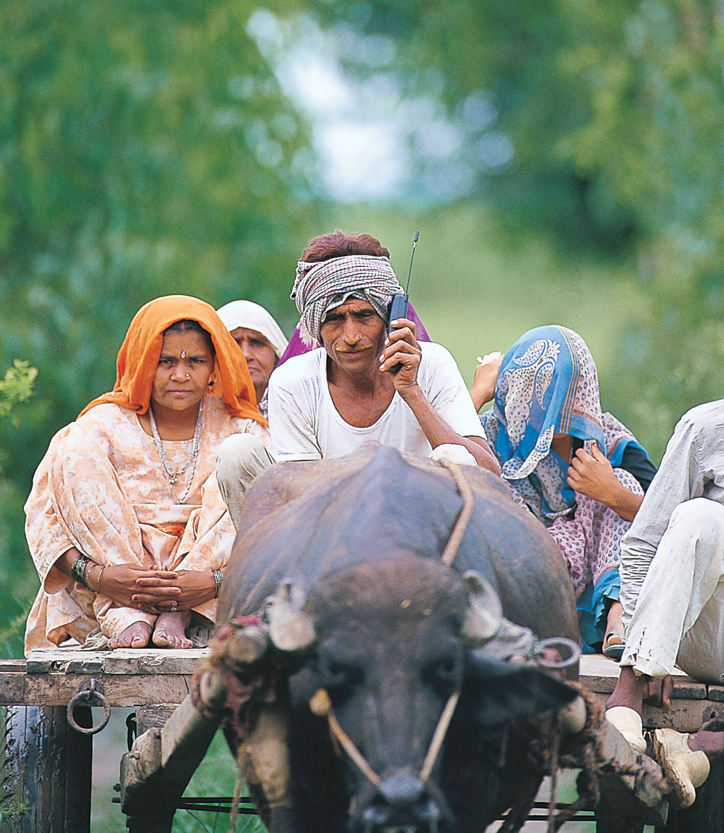<strong>1997</strong>                                                                      A farmer with his family sitting on a Bullock Cart and talking on a mobile Phone, in Delhi.