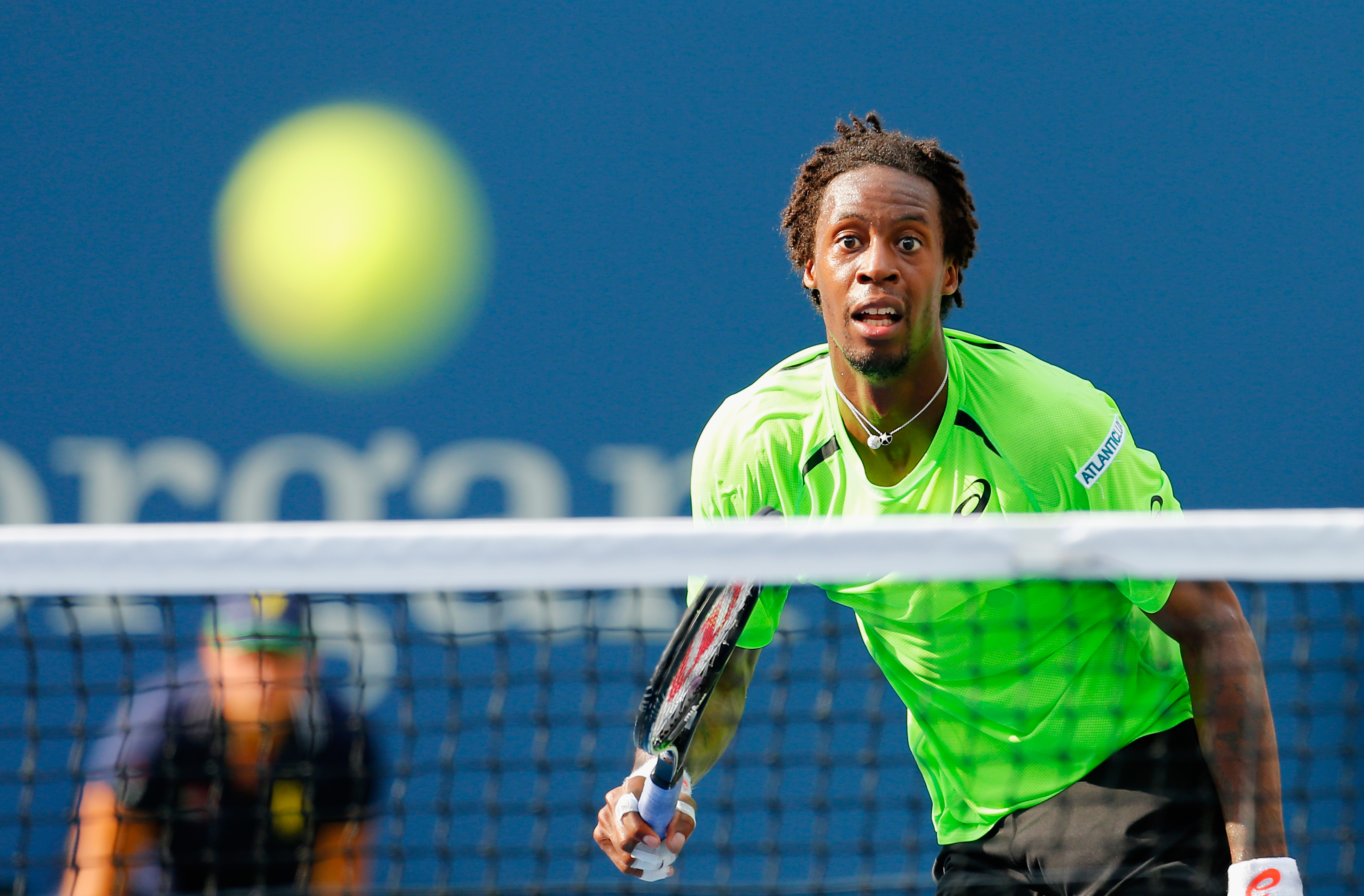 Gael Monfils of France returns a shot against Grigor Dimitrov of Bulgaria in their men's singles fourth round match on Day Nine of the 2014 US Open at the USTA Billie Jean King National Tennis Center on September 2, 2014 in Queens.