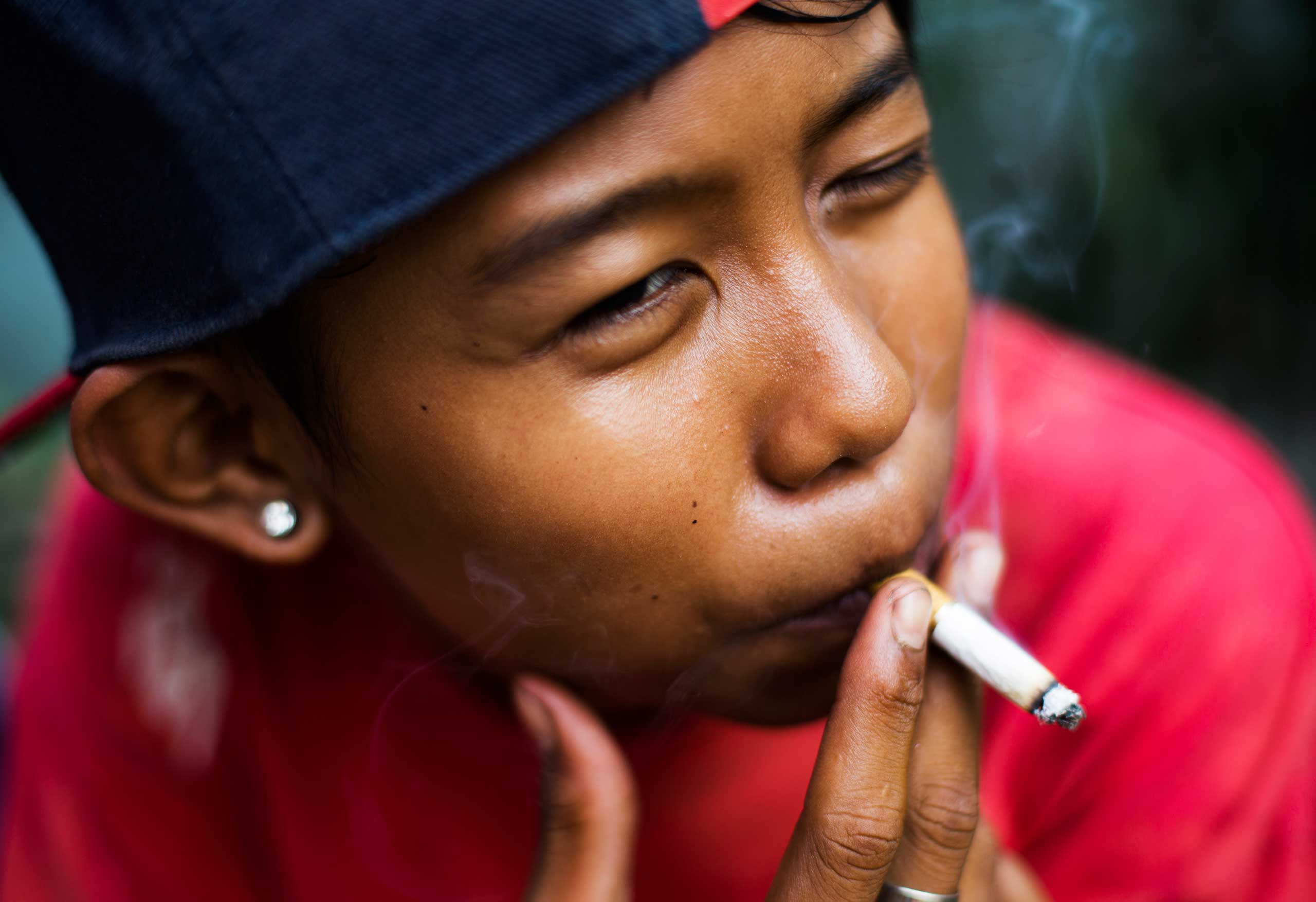 Ompong, which means  toothless  in Bahasa, poses for a photograph as he has a cigarette in South Jakarta, Indonesia on February 14, 2014.
