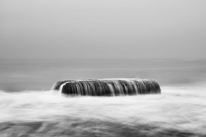 A concrete defensive structure used by the German Army in WWII is visible in the sea off the coast of Denmark along the route of the Atlantic Wall (Atlantikwall in German).