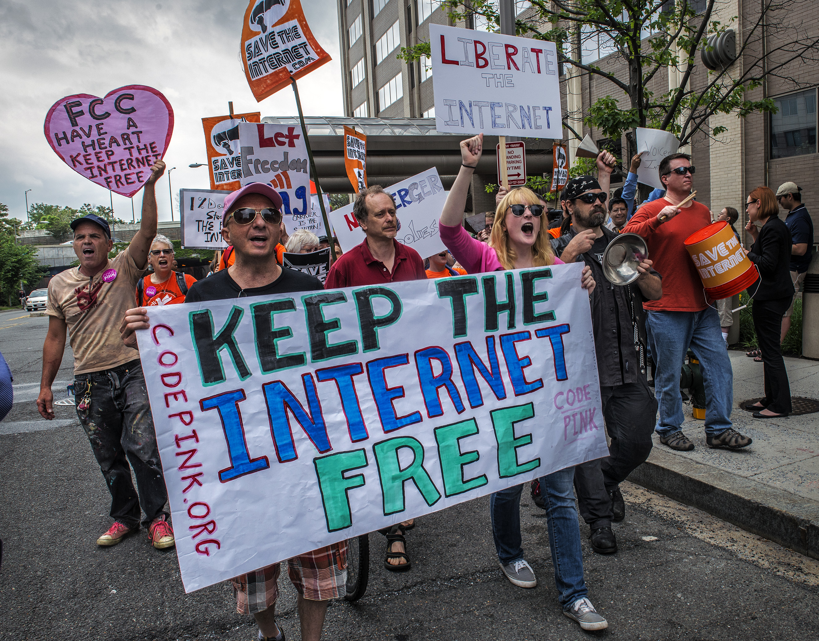 Protesters march past the FCC headquarters before the Commission meeting on net neutrality proposal on May, 15, 2014 in Washington.