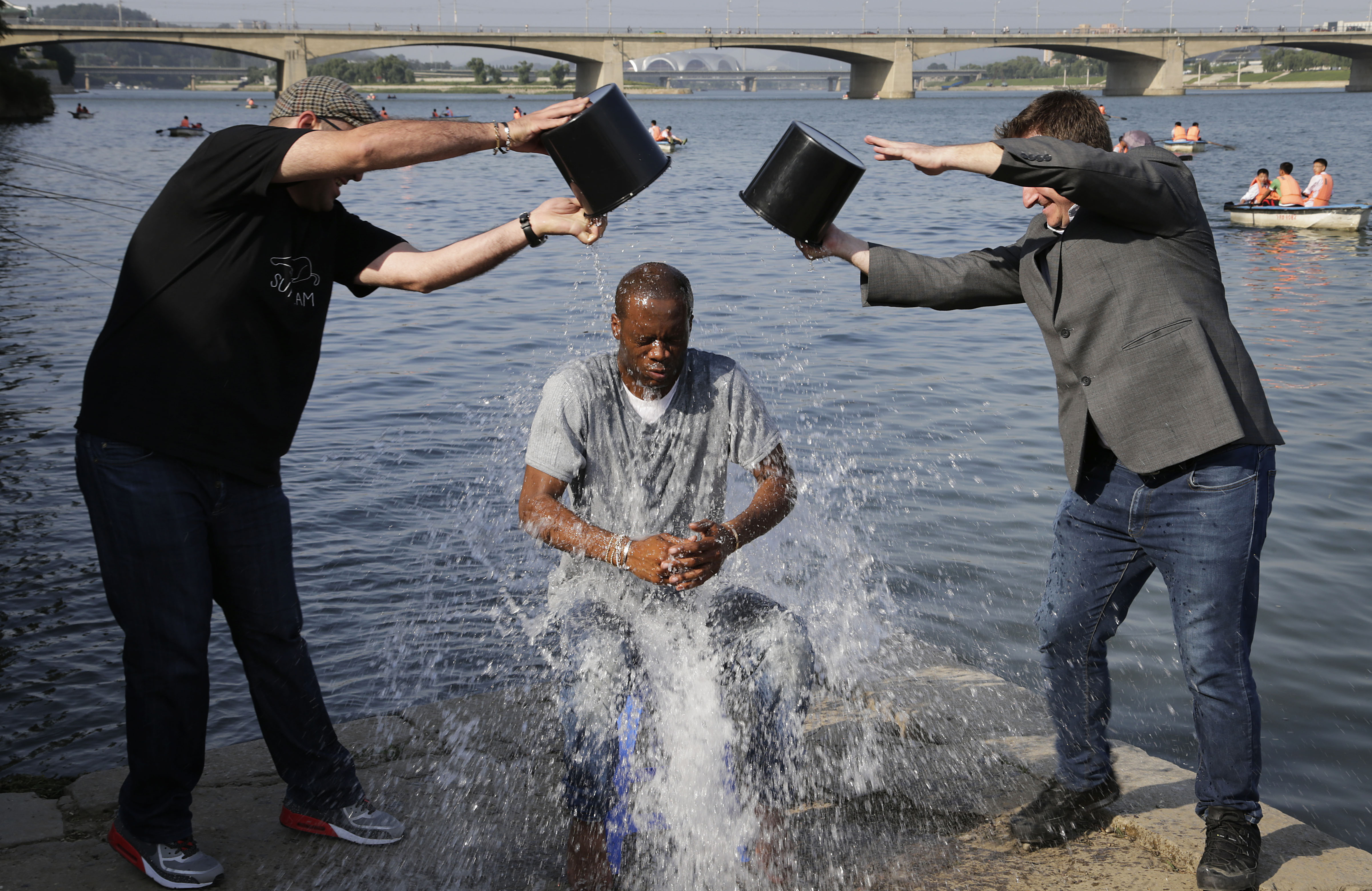 Two-time Grammy award winning rapper and a founding member of the Fugees, Pras Michel, gets doused by his friends for the ALS Ice Bucket Challenge, Sunday, Aug. 31, 2014 in Pyongyang, North Korea.