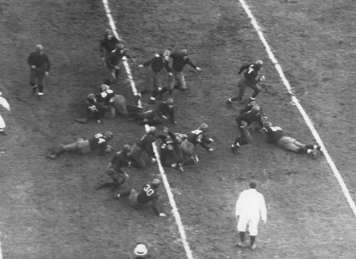 The Notre Dame Fighting Irish run on the field during a game circa 1931 at the Notre Dame Stadium in South Bend, Ind.