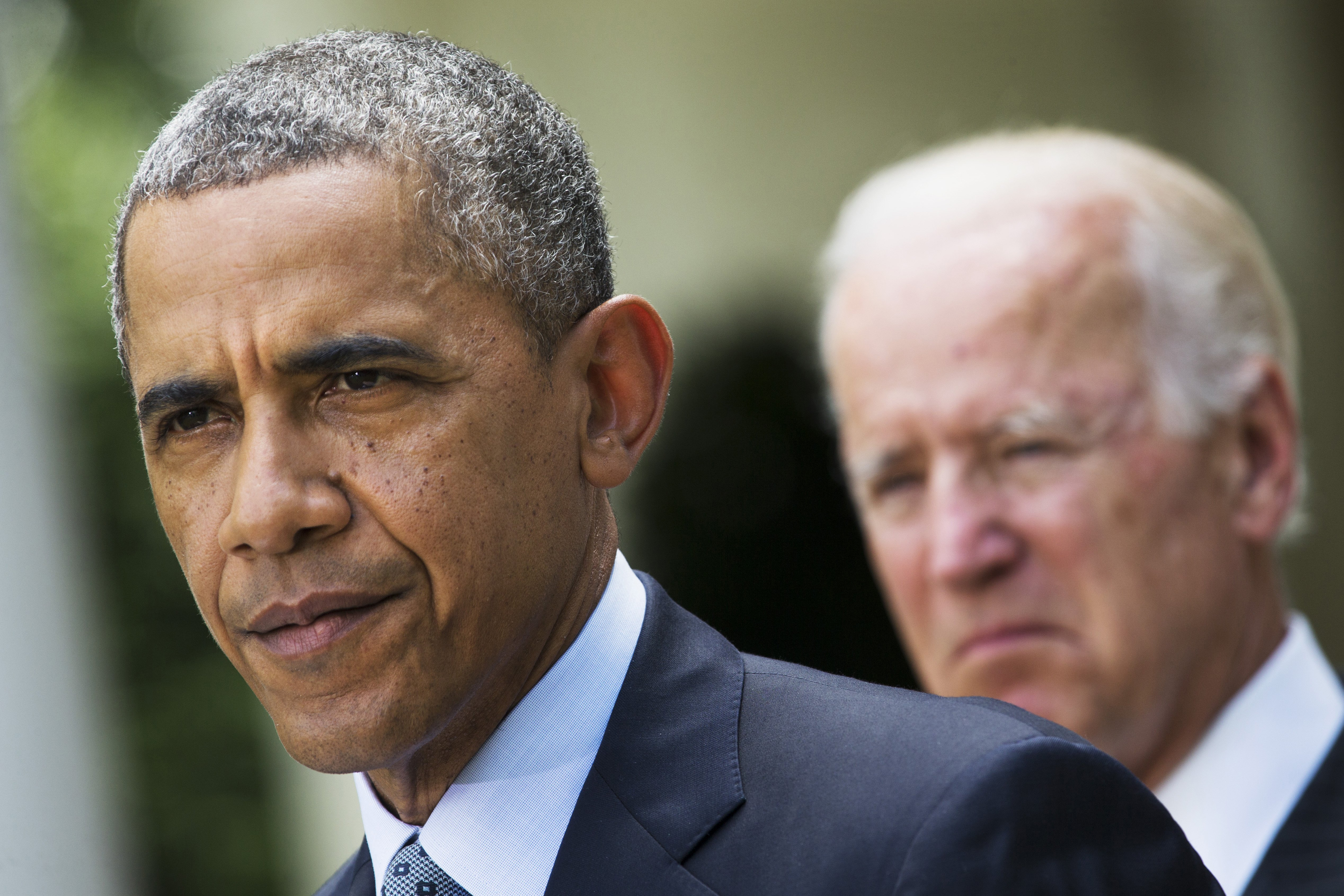 President Barack Obama, accompanied by Vice President Joe Biden, pauses while making a statement about immigration reform, in the Rose Garden of the White House in Washington on June 13, 2014.