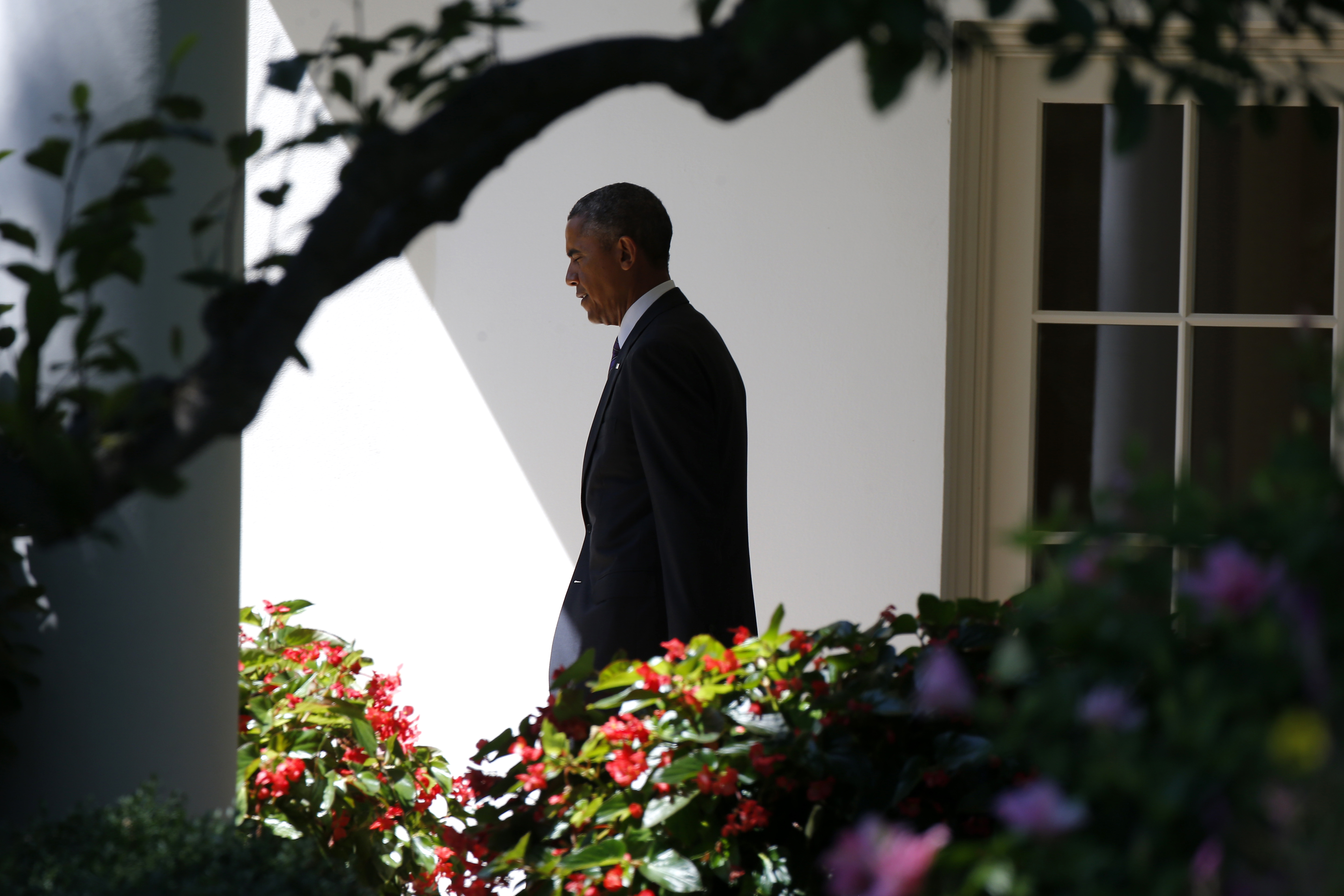President Barack Obama walks out of the Oval Office towards the South Lawn of the White House in Washington, on Aug. 29, 2014.