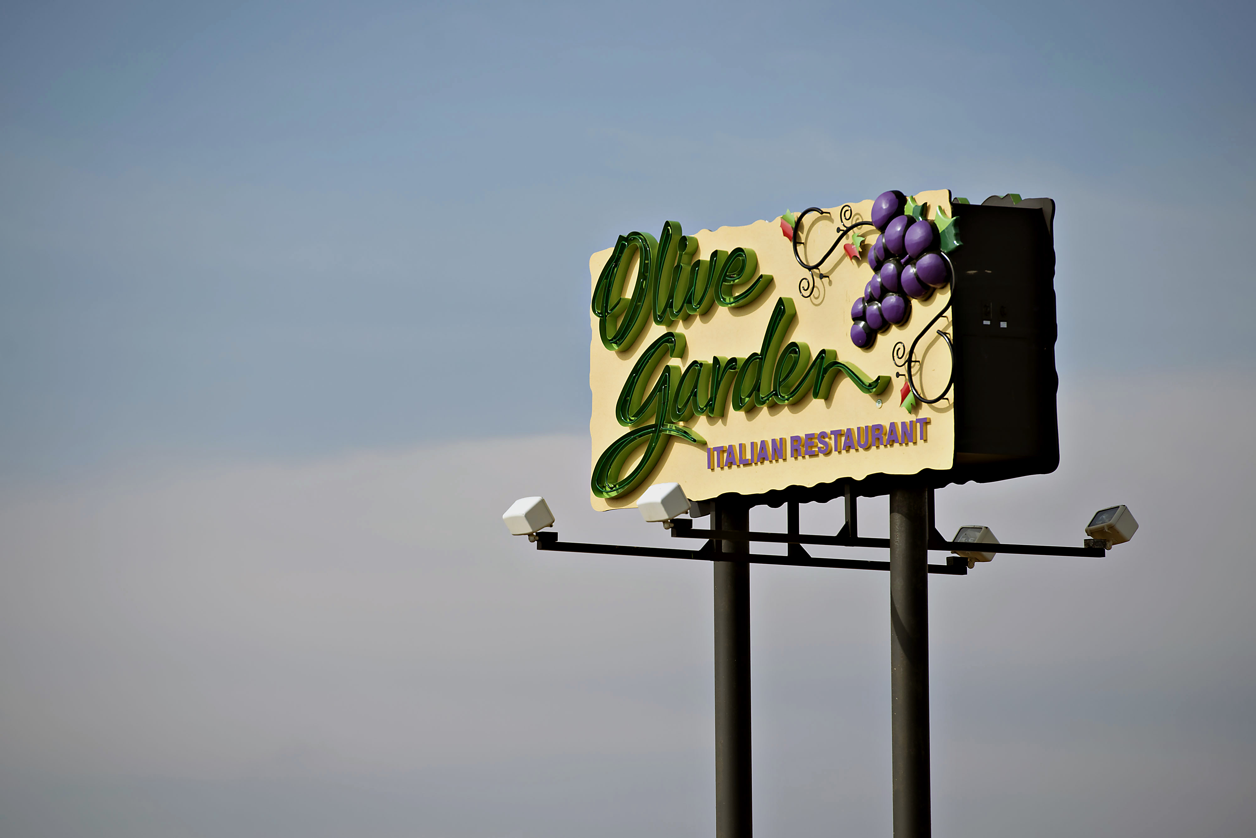 Darden Restaurants Inc. Olive Garden signage is displayed outside of a location in Peoria, Illinois, U.S., in March 2014.
