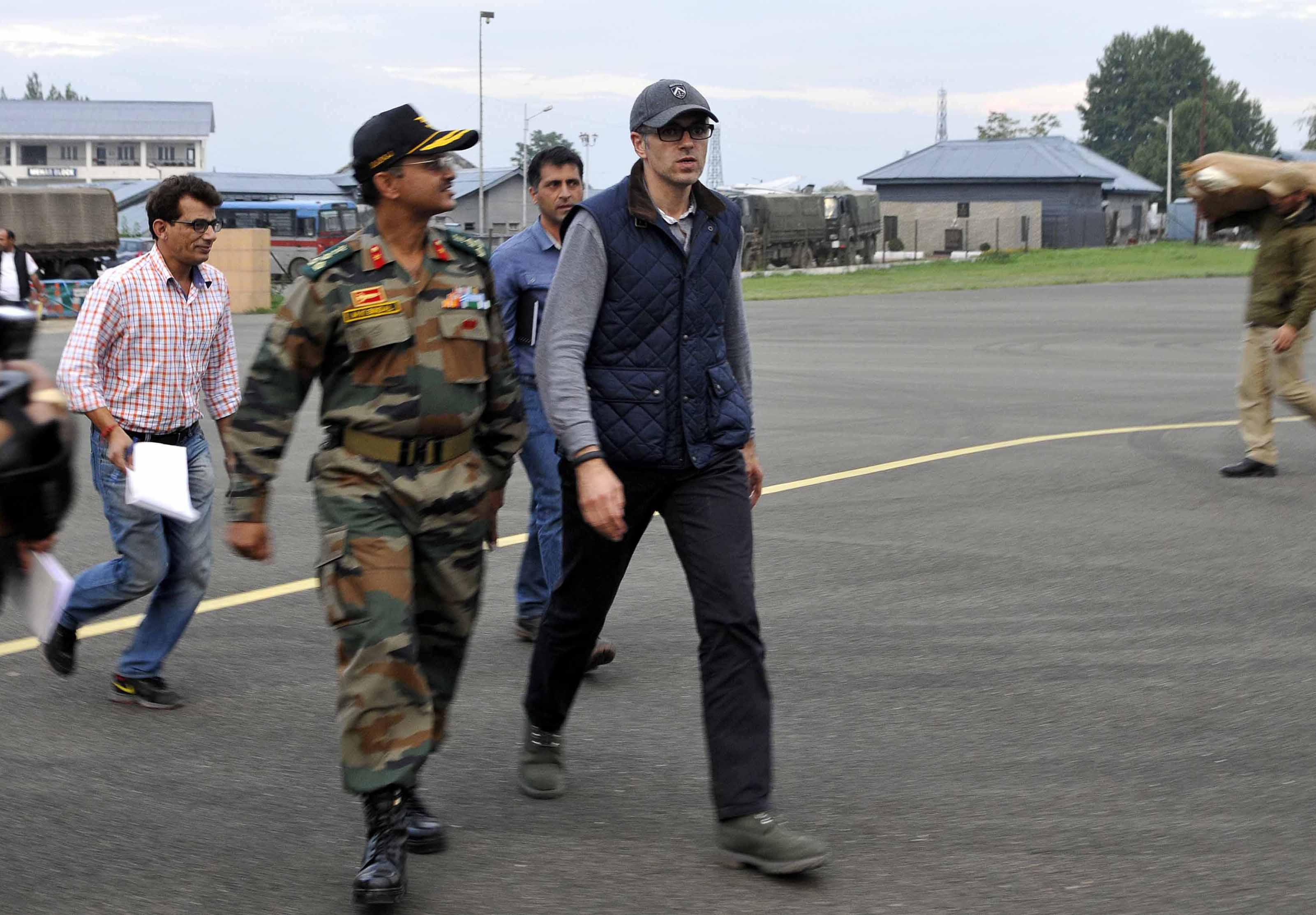 Jammu and Kashmir Chief Minister Omar Abdullah arrives at the airport to inspect the rescue and relief operations following flooding on September 9, 2014 in Srinagar, India.