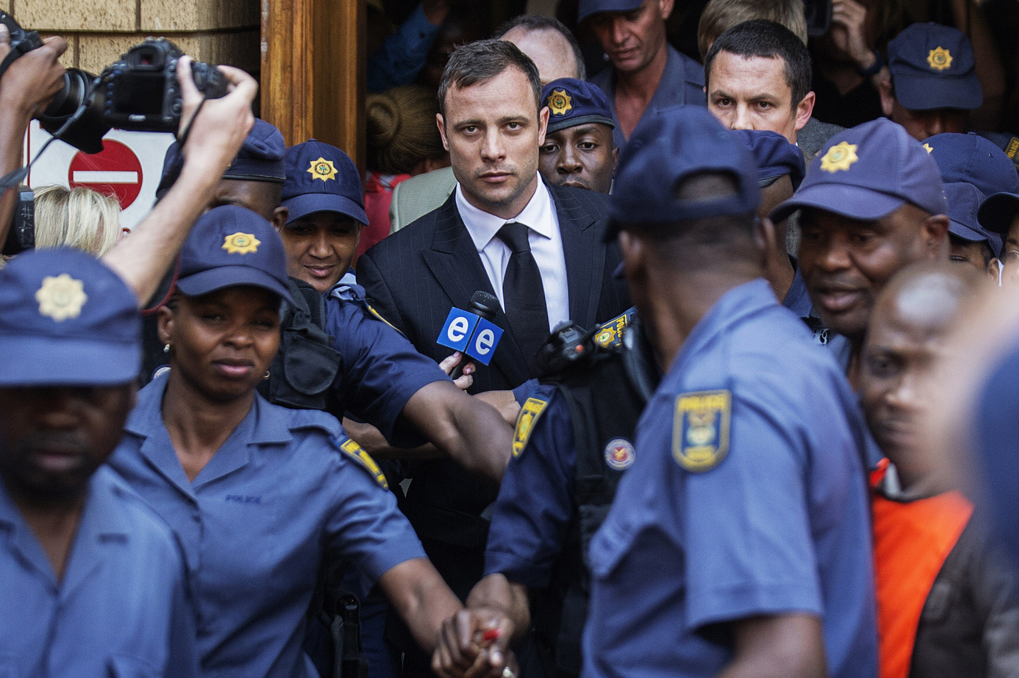 South African Paralympian athlete Oscar Pistorius leaves the High Court after the verdict in his murder trial where he was found guilty of culpable homicide in Pretoria, South Africa on Sept. 12, 2014.