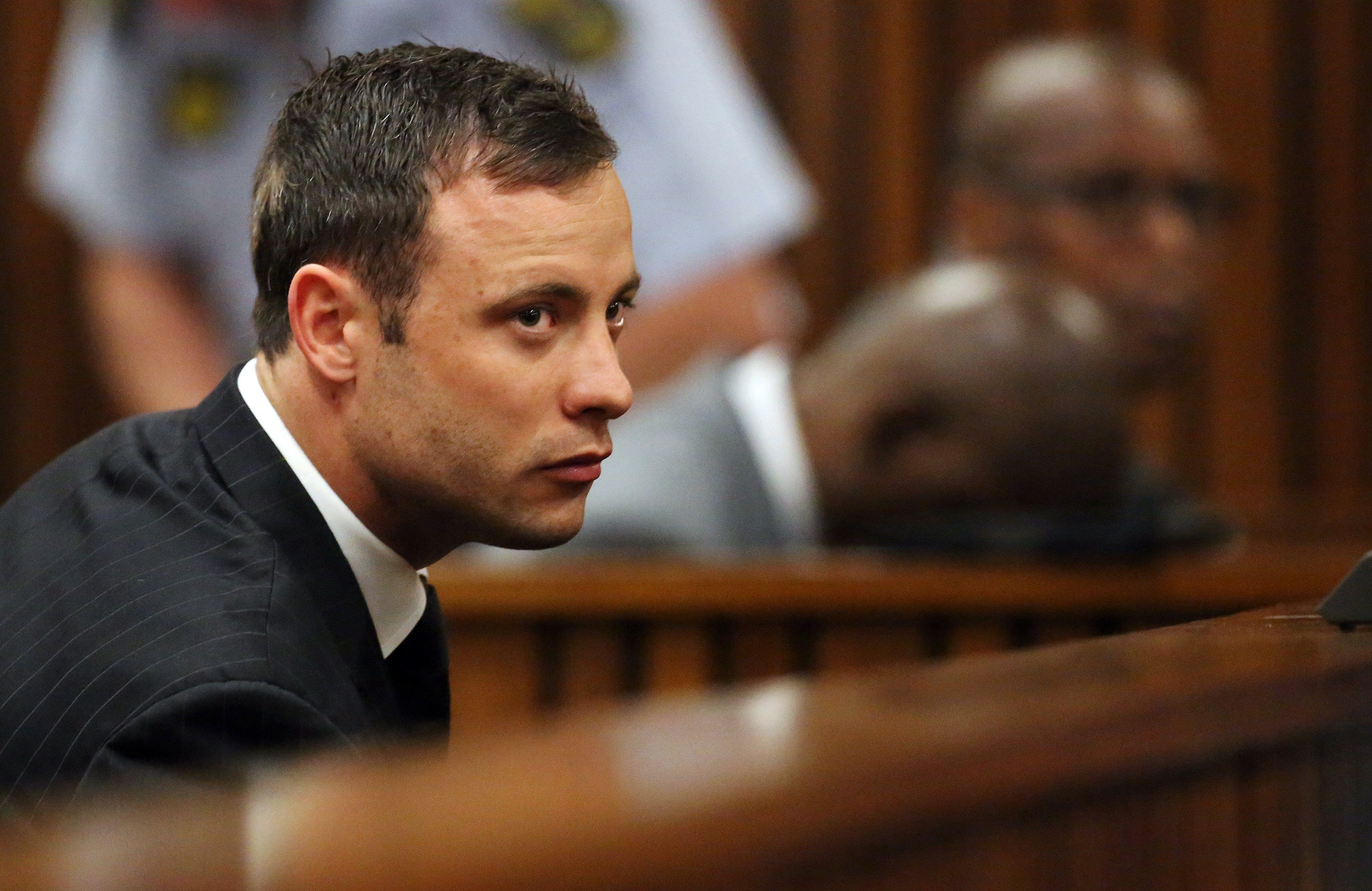 Oscar Pistorius listens to the verdict in his murder trial in the High Court in Pretoria on September 12, 2014.