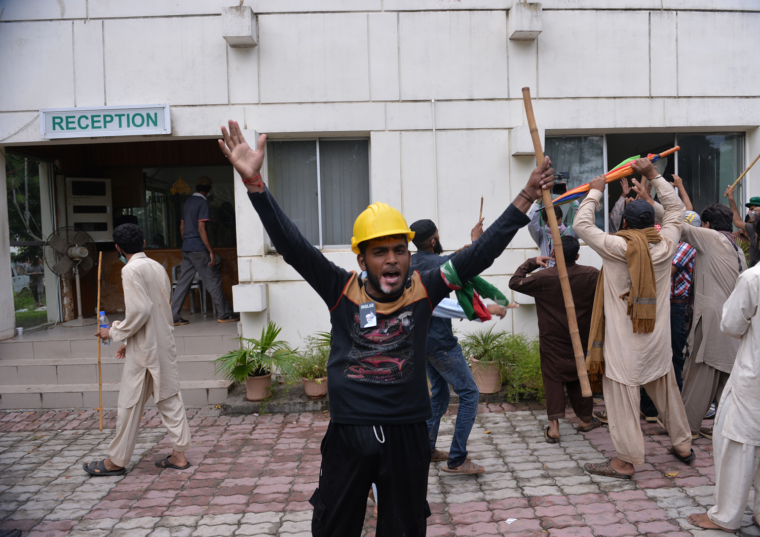 Pakistani supporters of politician-cleric Muhammad Tahir ul-Qadri and cricket turned politician Imran Khan shout antigovernment slogans after storming the headquarters of the state-owned Pakistani Television in Islamabad on Sept. 1, 2014