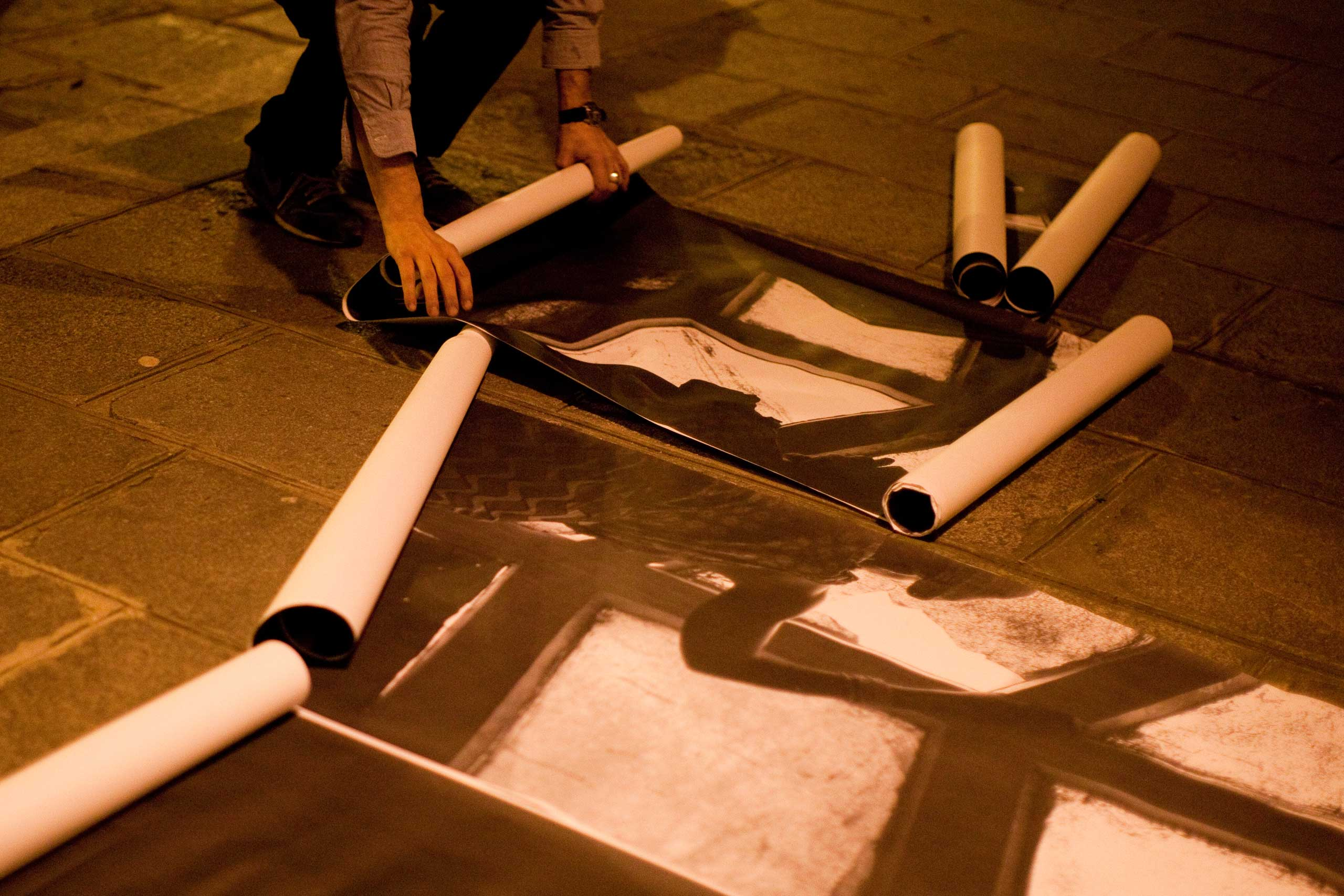 French photographer Pierre Terdjman prepares his posters as part of his Dysturb street art project.