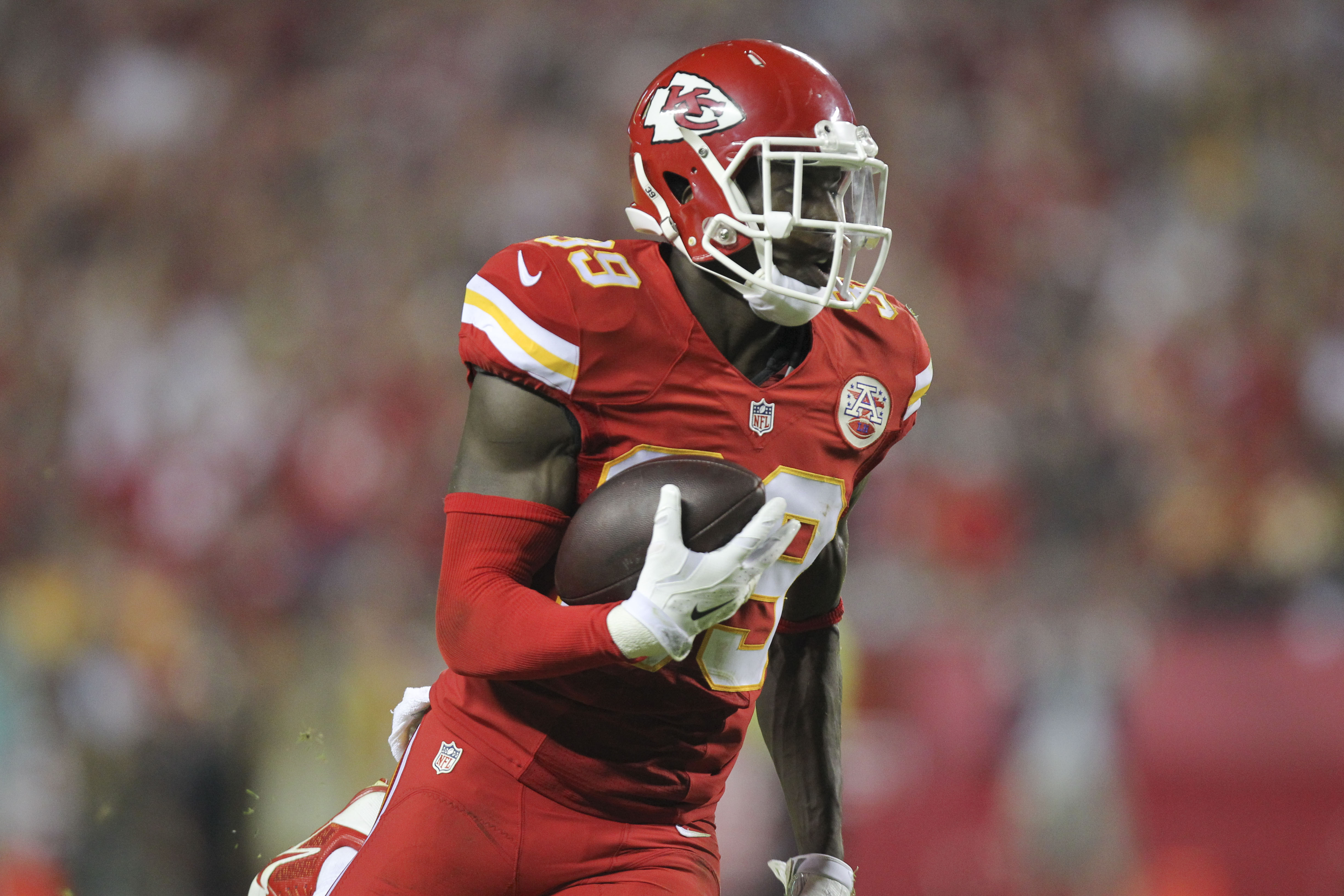 Kansas City Chiefs free safety Husain Abdullah carries the ball after intercepting a pass during the fourth quarter of an NFL football game against the New England Patriots Sept. 29, 2014, in Kansas City, Mo.
