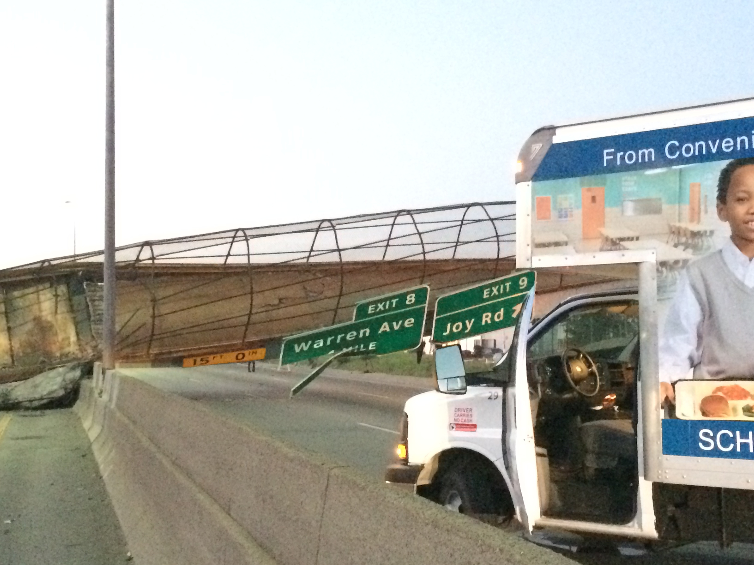 The Cathedral Road pedestrian bridge lies collapsed on the south M-39 highway after a truck hit it on Sept. 26, 2014, in Detroit.