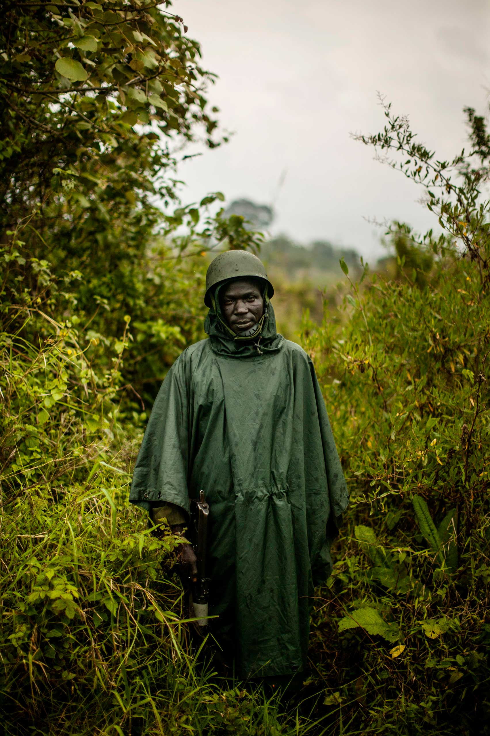A Congolese soldier stands at the farthest advance point in Kibumba, outside Goma.