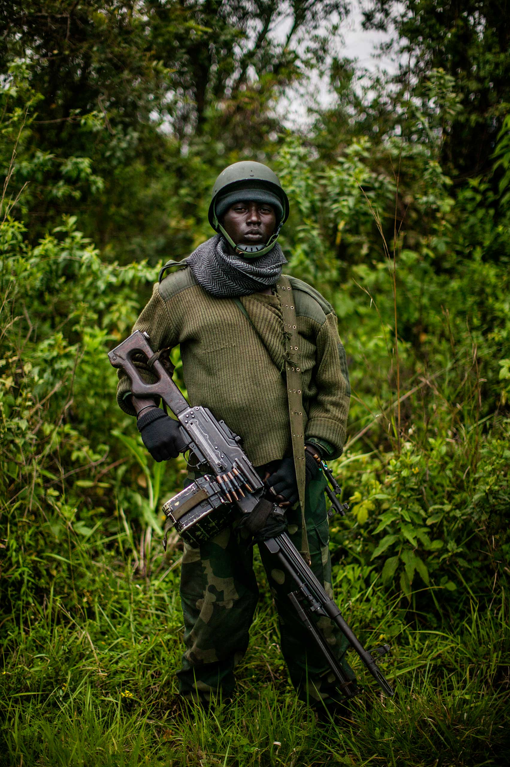 A Congolese soldier stands along the frontline north of Goma.