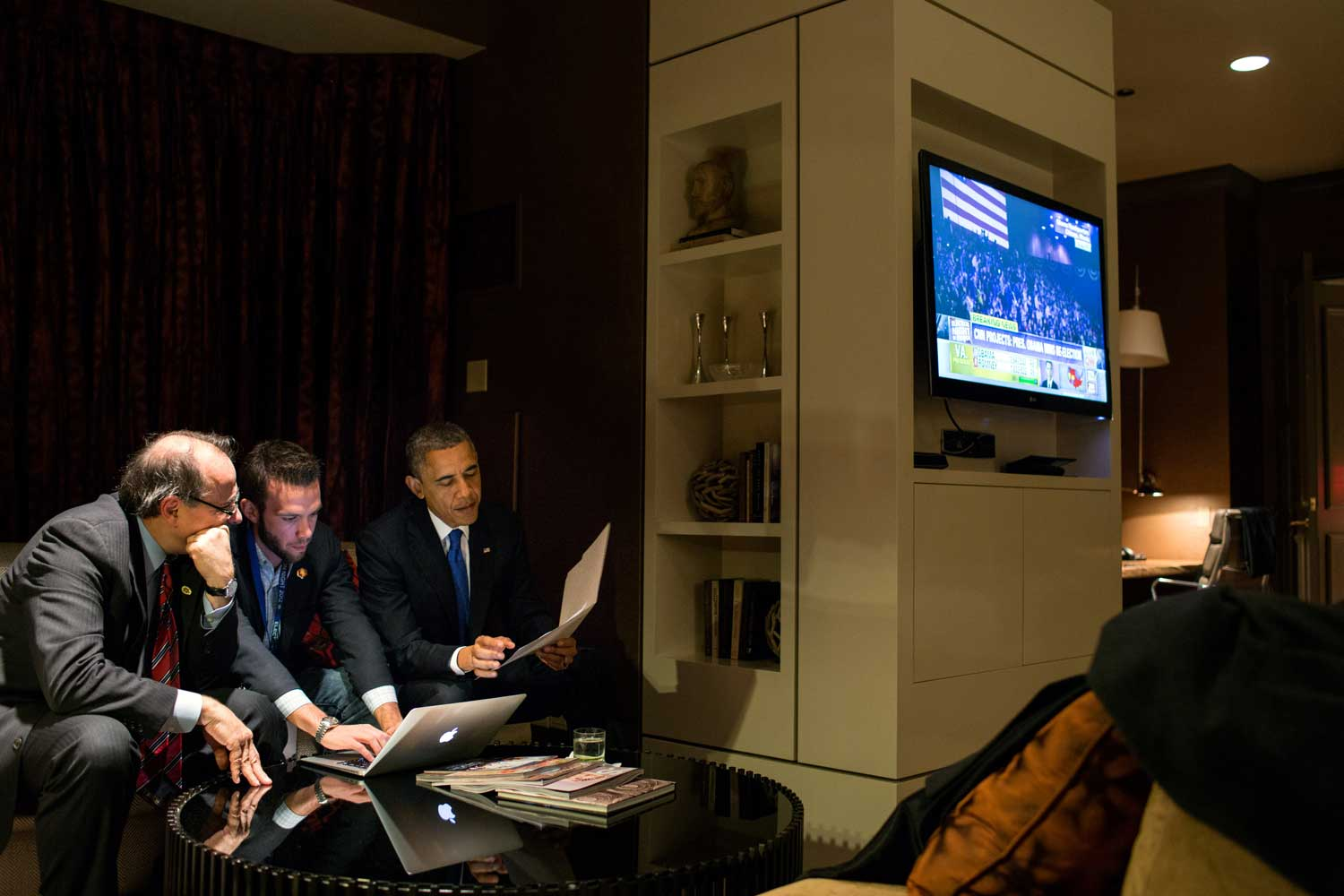 President Barack Obama reviews his election speech with Jon Favreau, Director of Speechwriting, and David Axelrod in the Presidential Suite at the Fairmont Chicago Millennium Park in Chicago, Ill., Nov. 6, 2012.