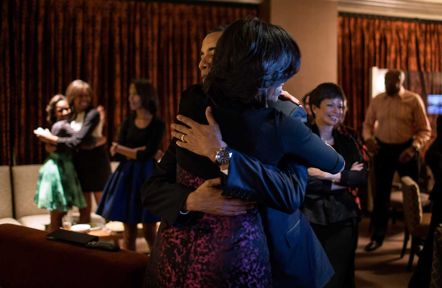 President Barack Obama and First Lady Michelle Obama embrace after watching CNN project the outcome of the election, at the Fairmont Chicago Millennium Park in Chicago, Ill., Nov. 6, 2012.