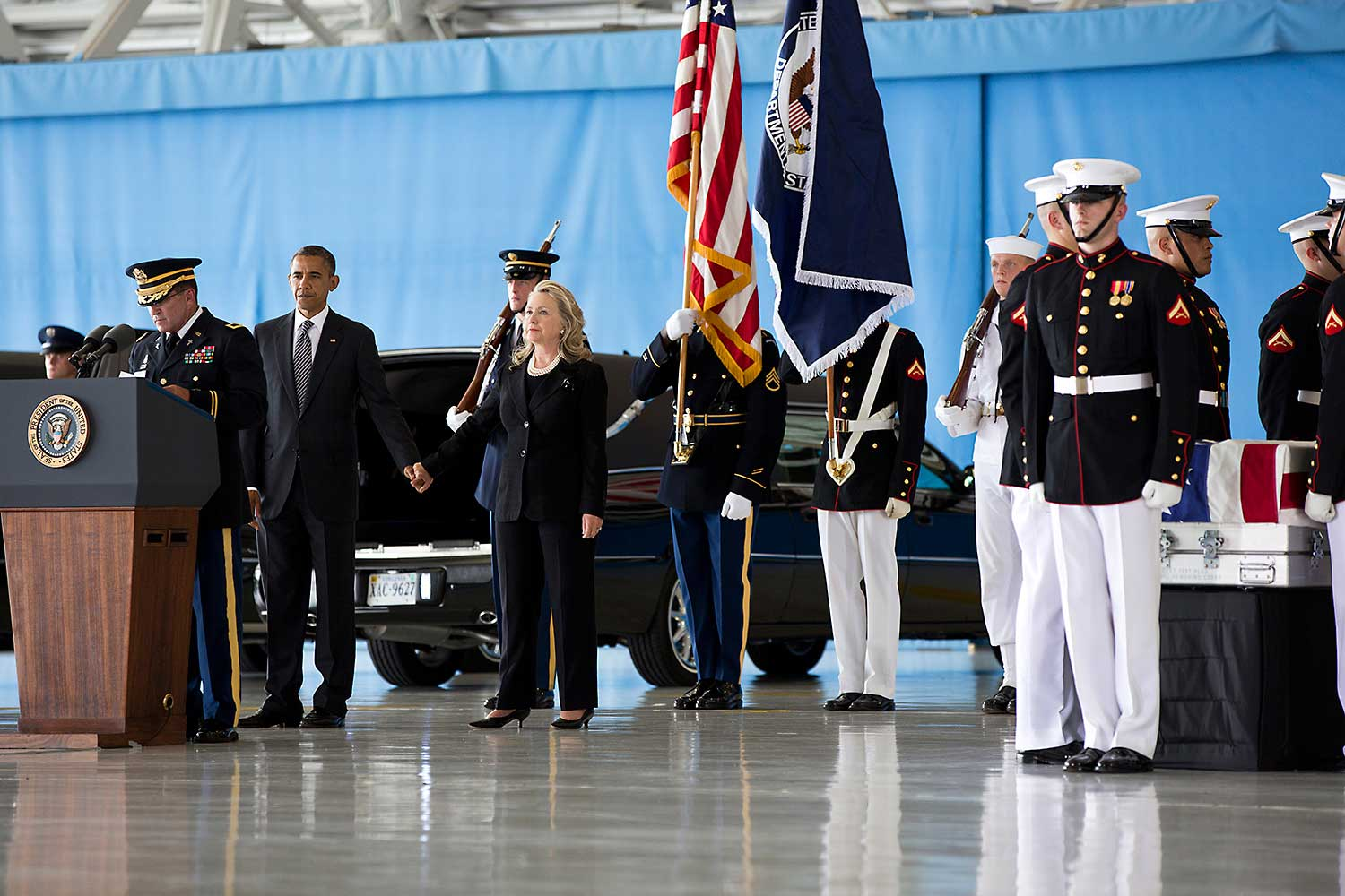 President Barack Obama, Vice President Joe Biden and Secretary of State Hillary Rodham Clinton attend the dignified transfer at Joint Base Andrews, Maryland, Sept. 14, 2012, of J. Christopher Stevens, U.S. Ambassador to Libya; Sean Smith, Information Management Officer; and Security Personnel Glen Doherty and Tyrone Woods, who were killed in the attack on the U.S. Consulate in Benghazi, Libya.