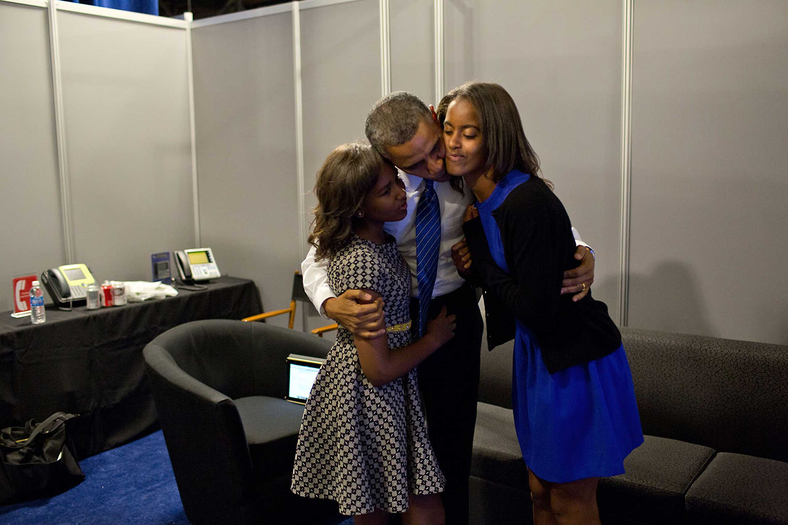 President Obama greets daughters Sasha and Malia at the Time Warner Cable Arena before delivering remarks at the Democratic National Convention in Charlotte, N.C., Sept. 6, 2012.