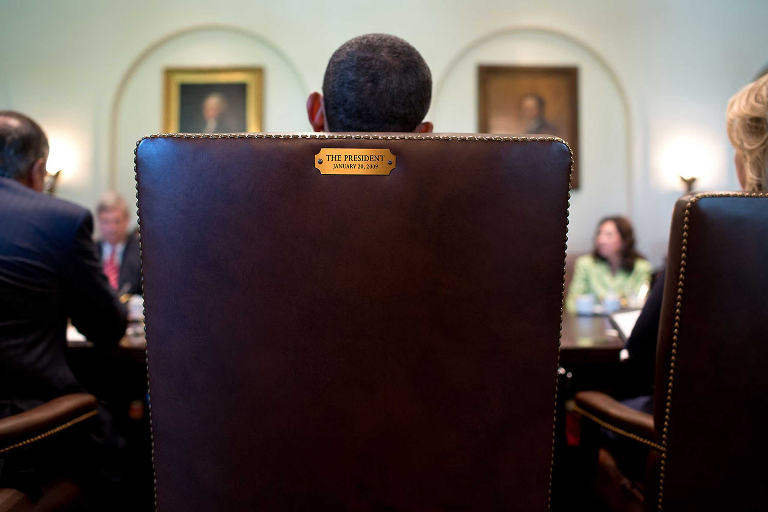 A view from behind of the President as he holds a Cabinet meeting in the Cabinet Room of the White House, July 26, 2012.