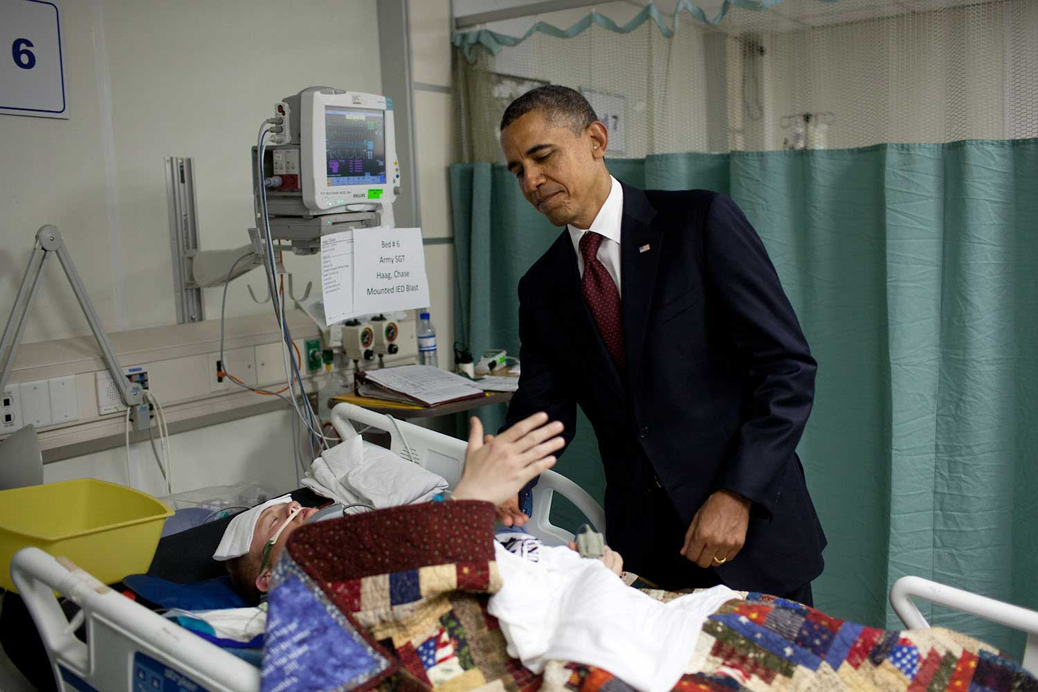 This was one of the most poignant moments of the President's first term. He was visiting wounded warriors in the intensive care unit ICU at Bagram Air Field, Afghanistan, May 1, 2012. He had just presented a Purple Heart to Sgt. Chase Haag, who had been injured by an IED just hours before. Sgt. Haag was covered with a blanket and it was difficult to see how badly he was injured. He was also seemingly unconscious so the President whispered in his ear so not to wake him. Just then, there was a rustling under the blanket and Sgt. Haag, eyes still closed, reached his hand out to shake hands with the President.