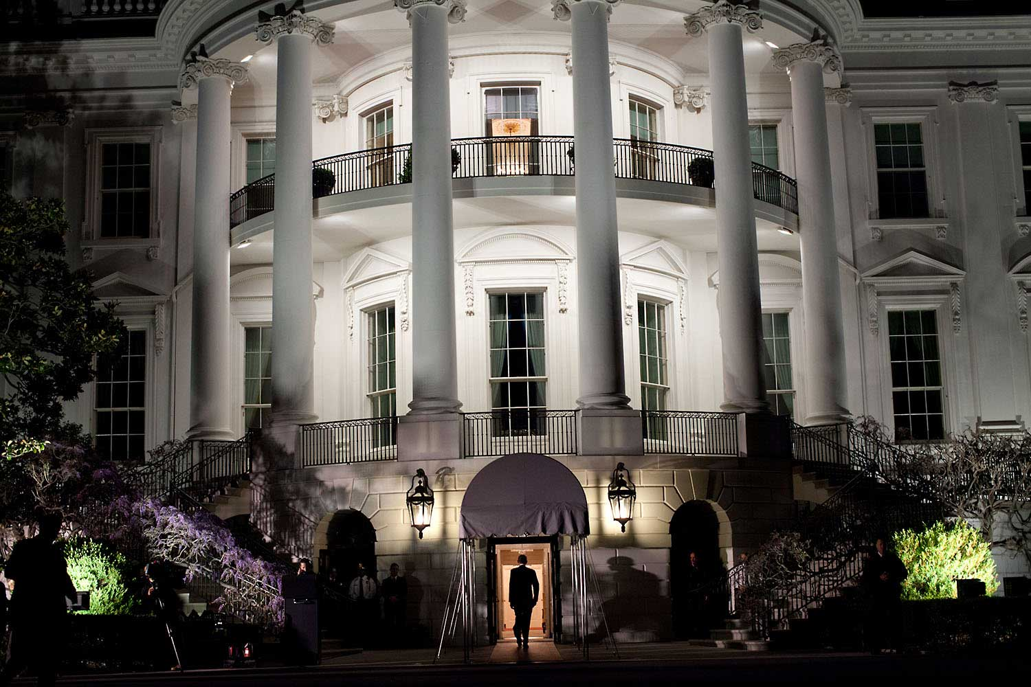 President Obama enters the White House at the South Portico following his arrival aboard Marine One on the South Lawn, March 30, 2012. The President returned from a trip to Vermont and Maine.