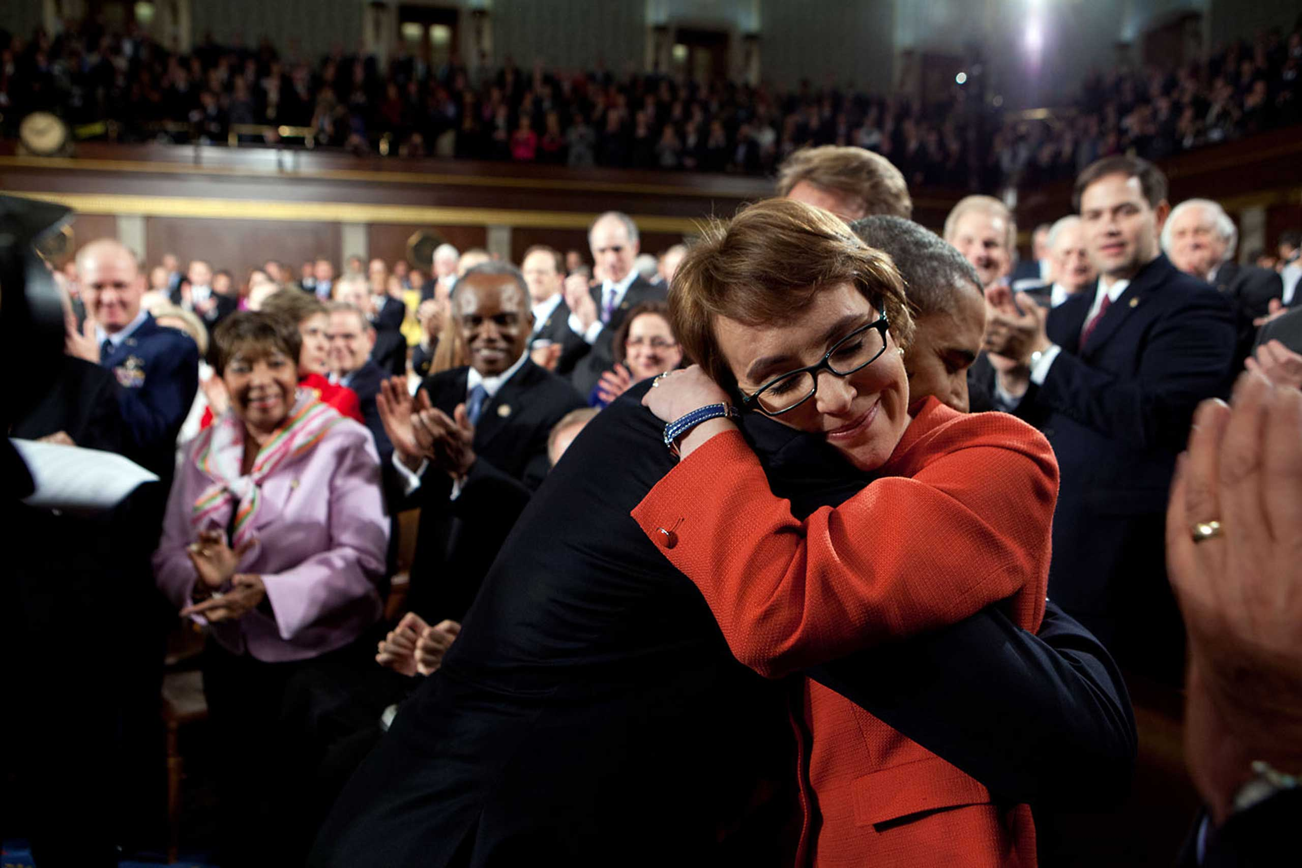 President Barack Obama greets then Rep. Gabrielle Giffords, D-Ariz., as he arrives to deliver the State of the Union address in the House Chamber at the U.S. Capitol in Washington, D.C., Jan. 24, 2012.