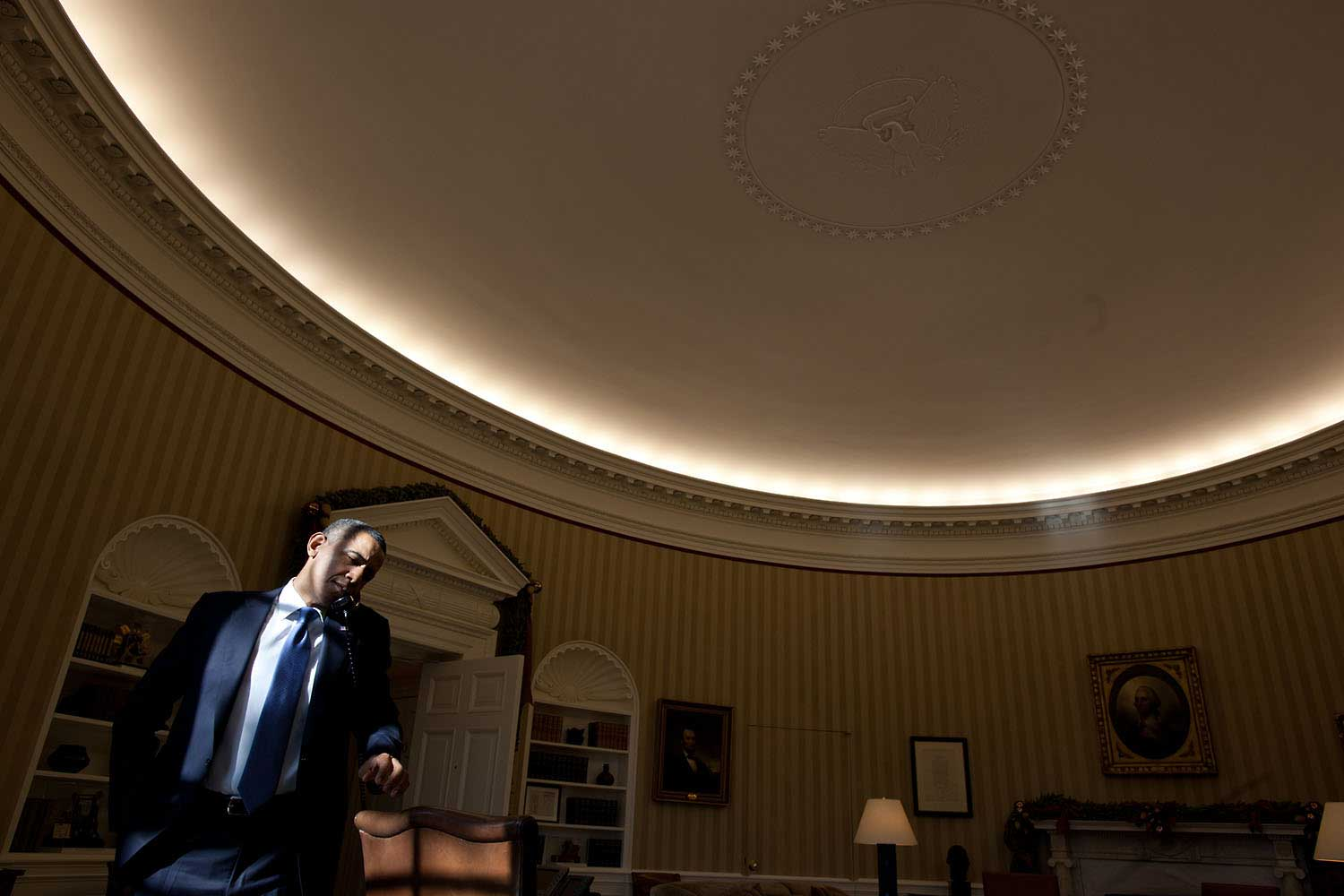 A splash of sunlight falls on the President's face as he makes a phone call in the Oval Office, Dec. 19, 2011.